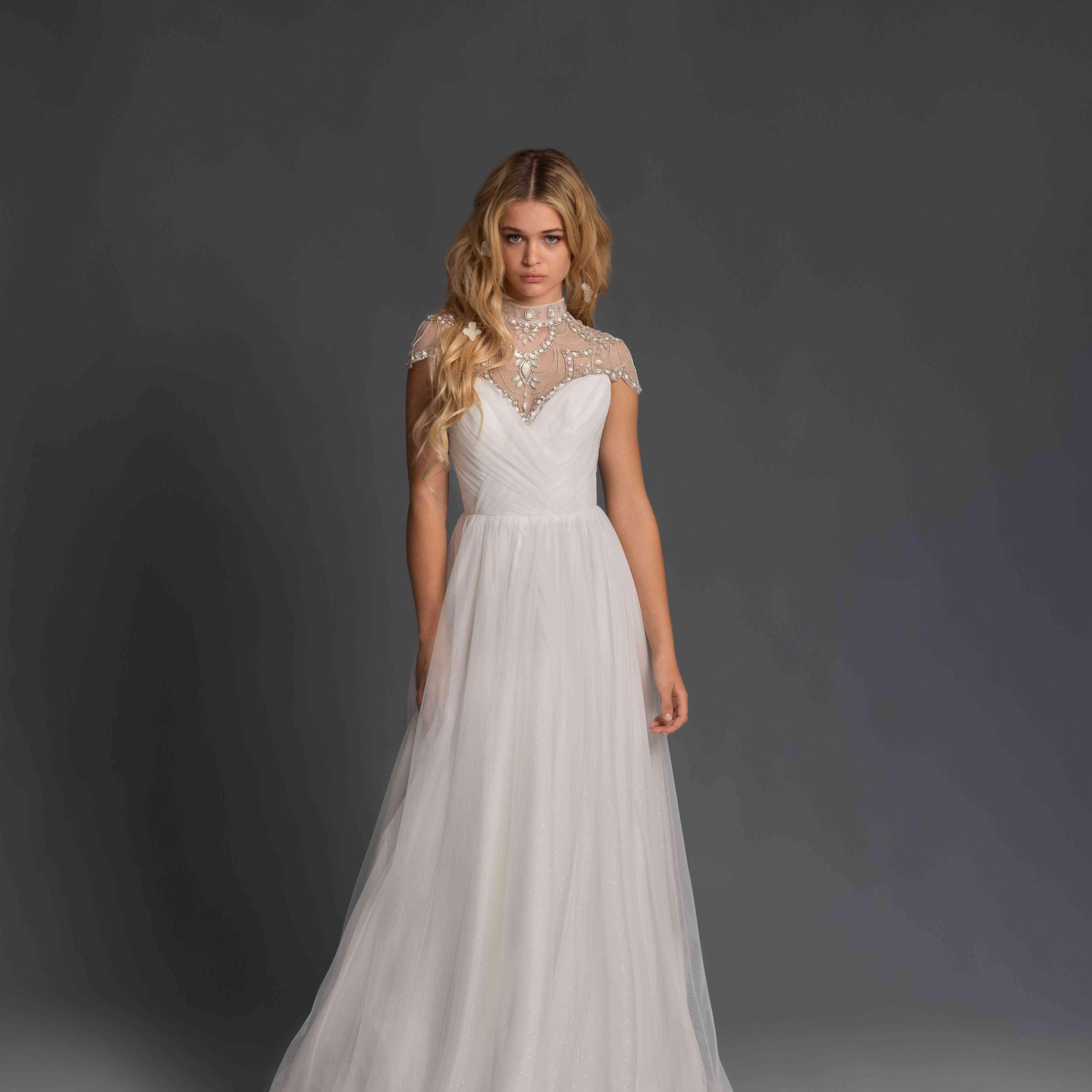 Model in high neck short sleeve wedding dress