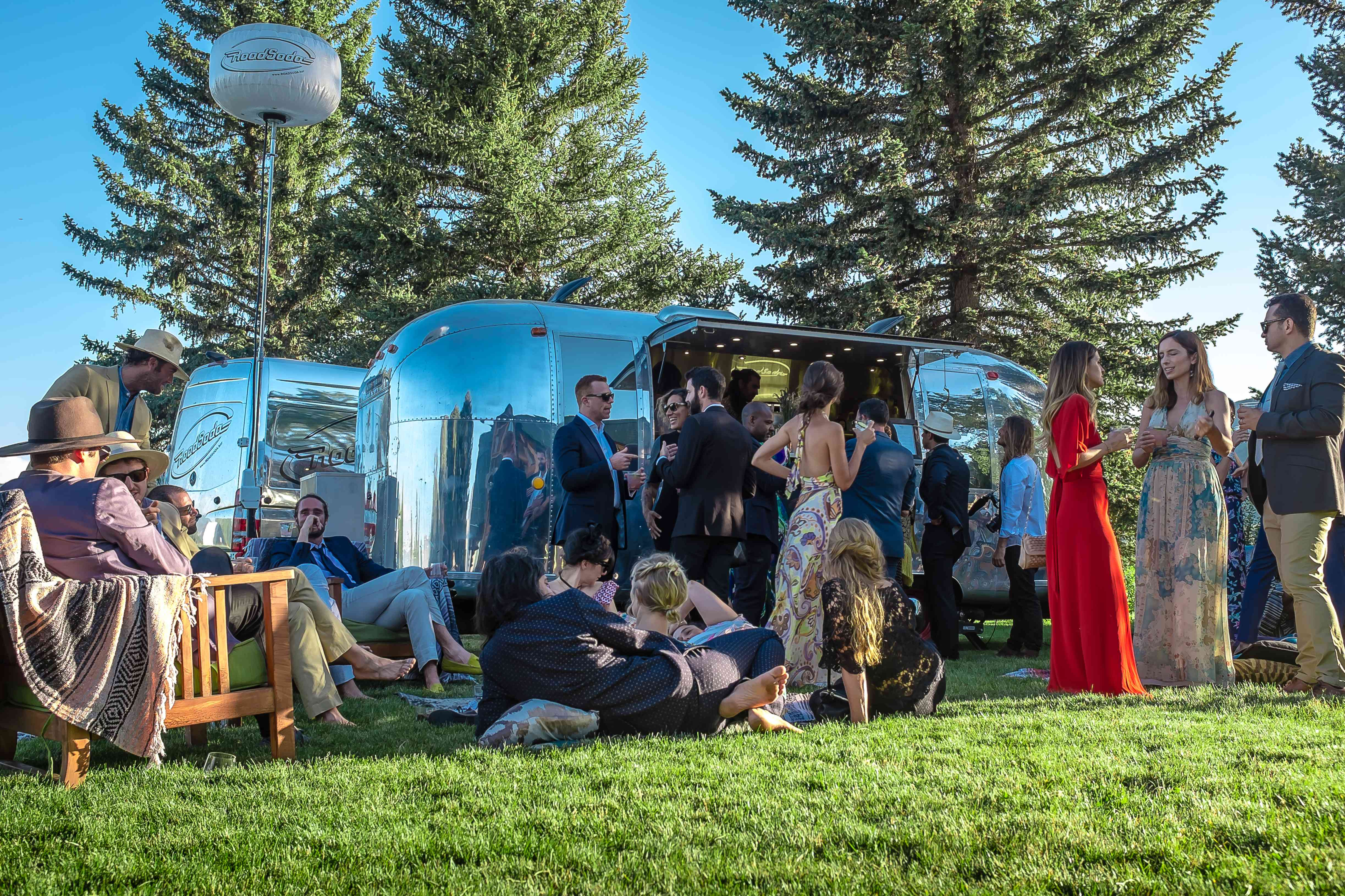 Utah wedding outside under trees, reception guests drinking from mobile bar, Road Soda