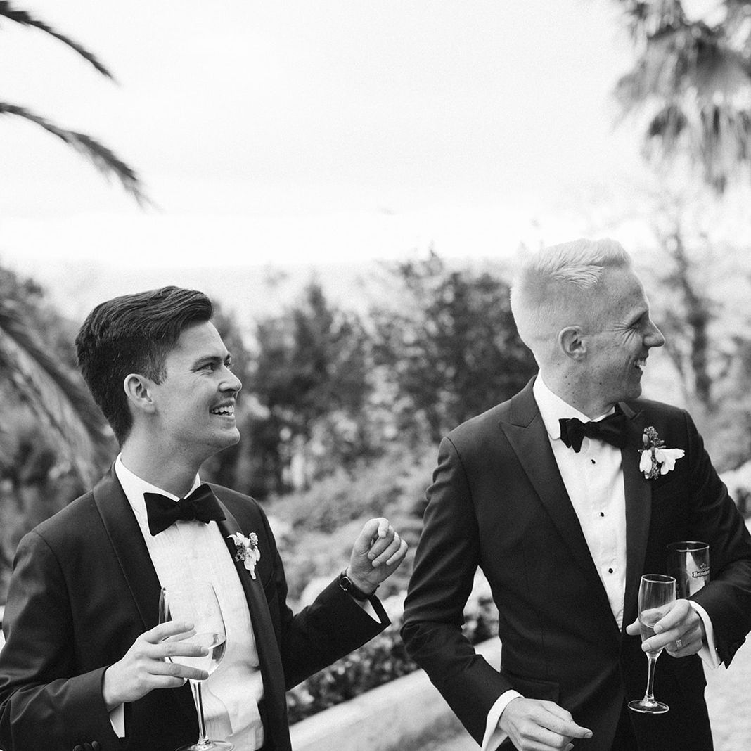 The grooms during cocktail hour