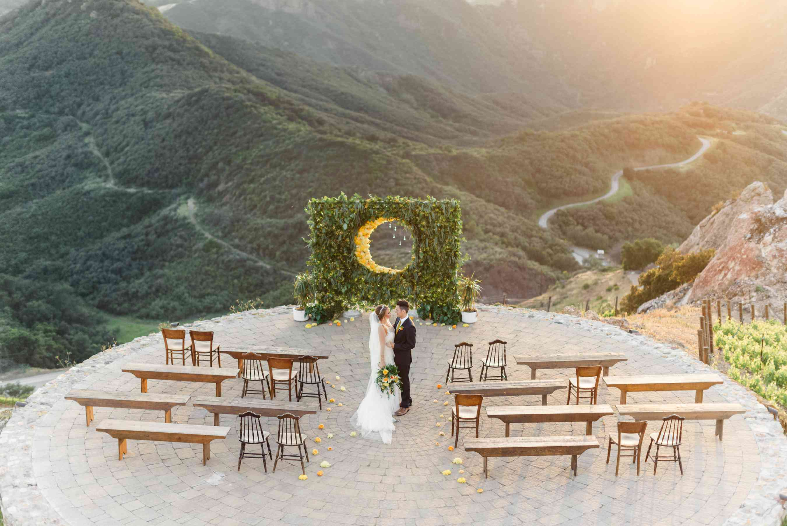 Wedding ceremony with mountain landscape backdrop