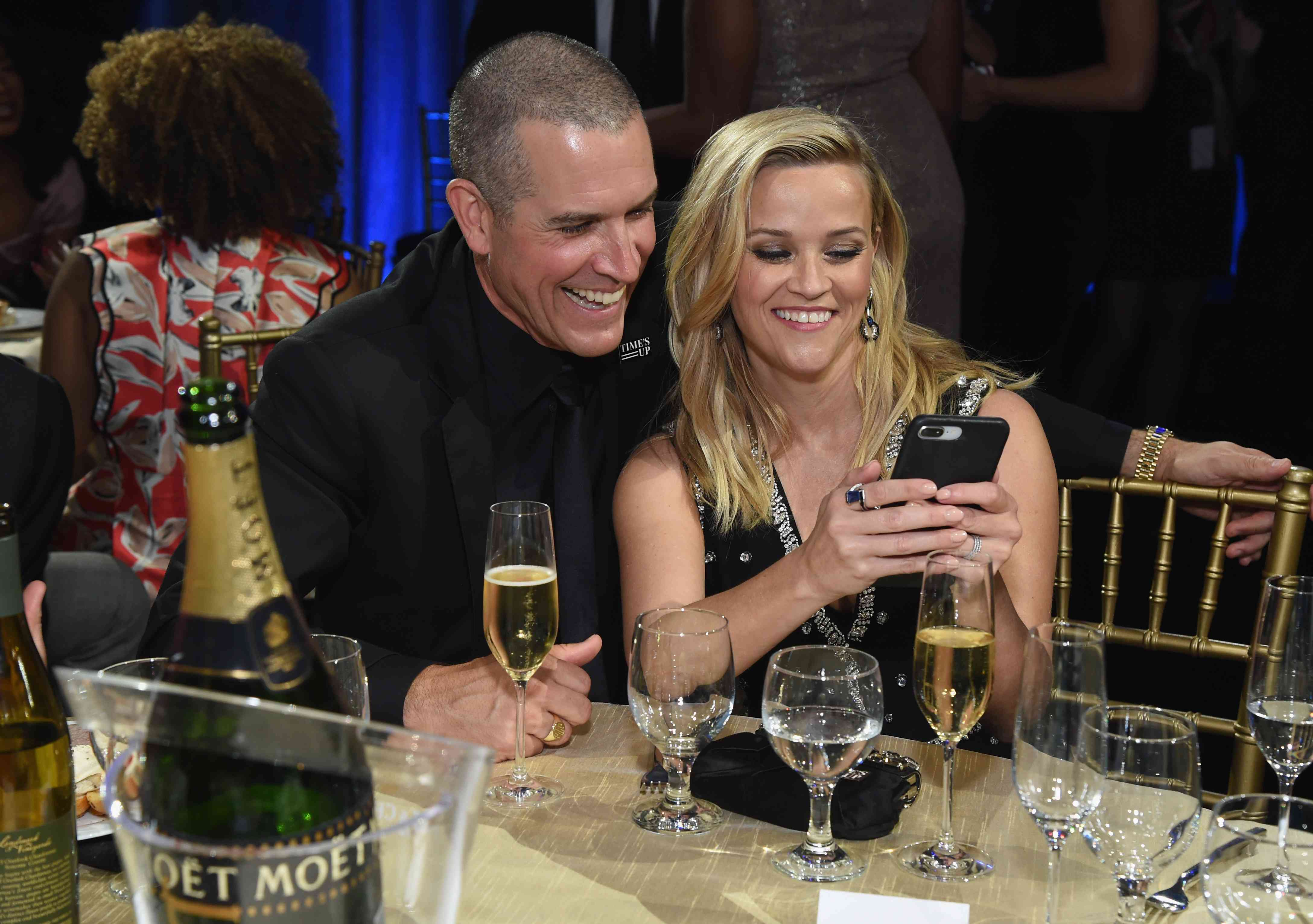 Jim Toth and Reese Witherspoon sitting together