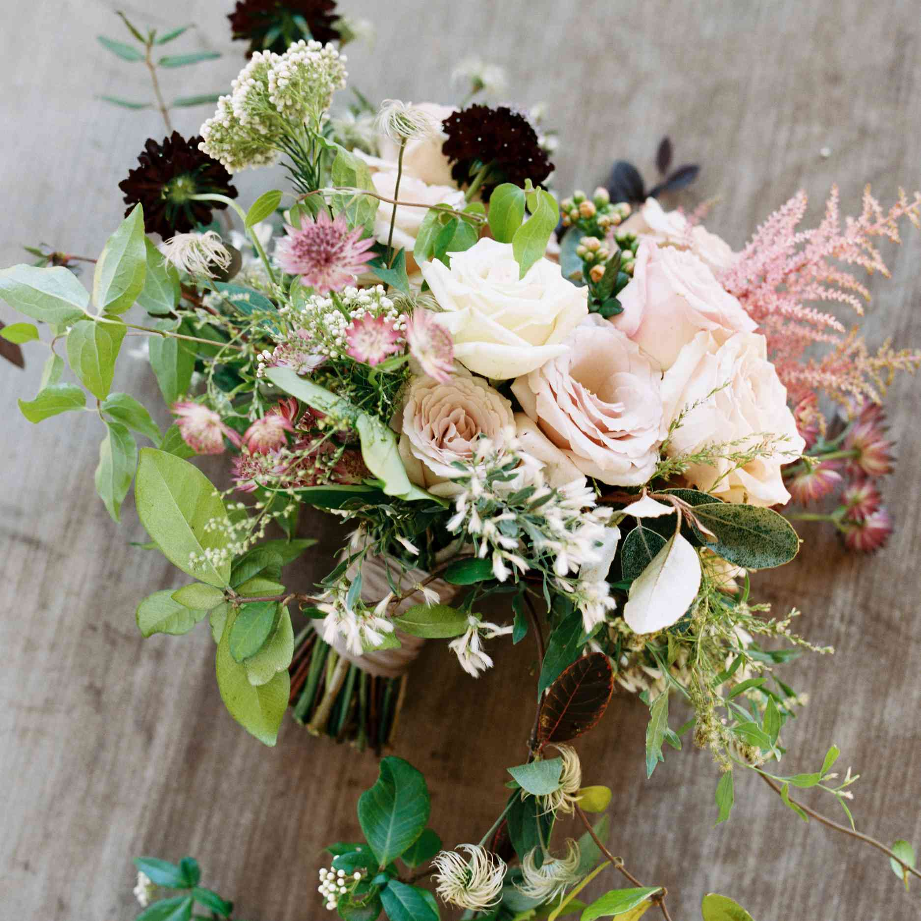 Bridal bouquet consisting of rice flower, hellebores, kalanchoe, Japanese clematis, and smokebush