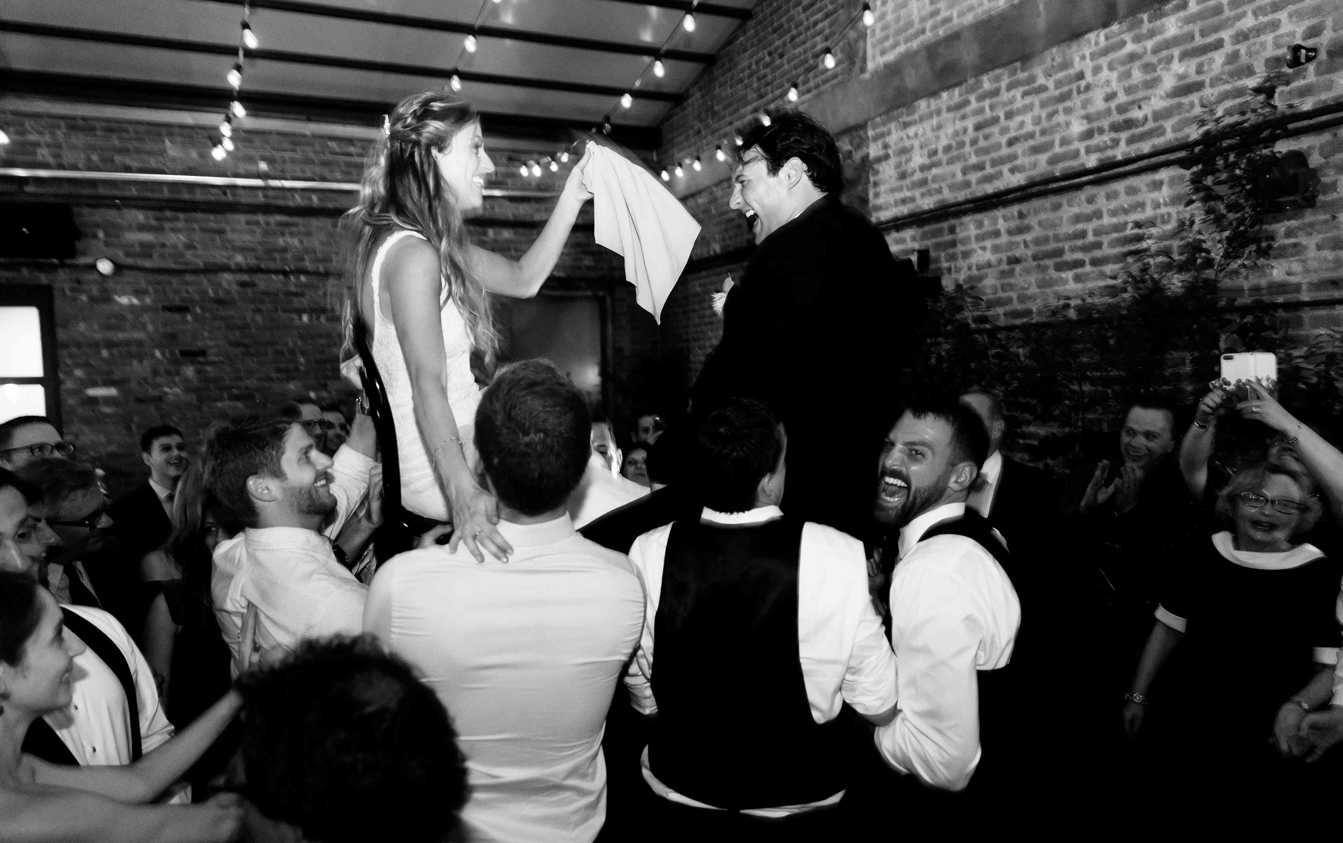 <p>couple dancing on chairs</p><br><br>