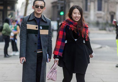 a man and woman walking down a sidewalk