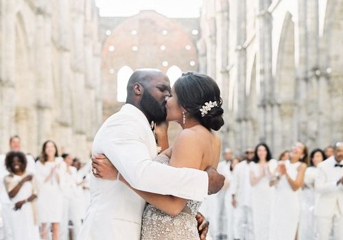 Bride and groom kissing after vows