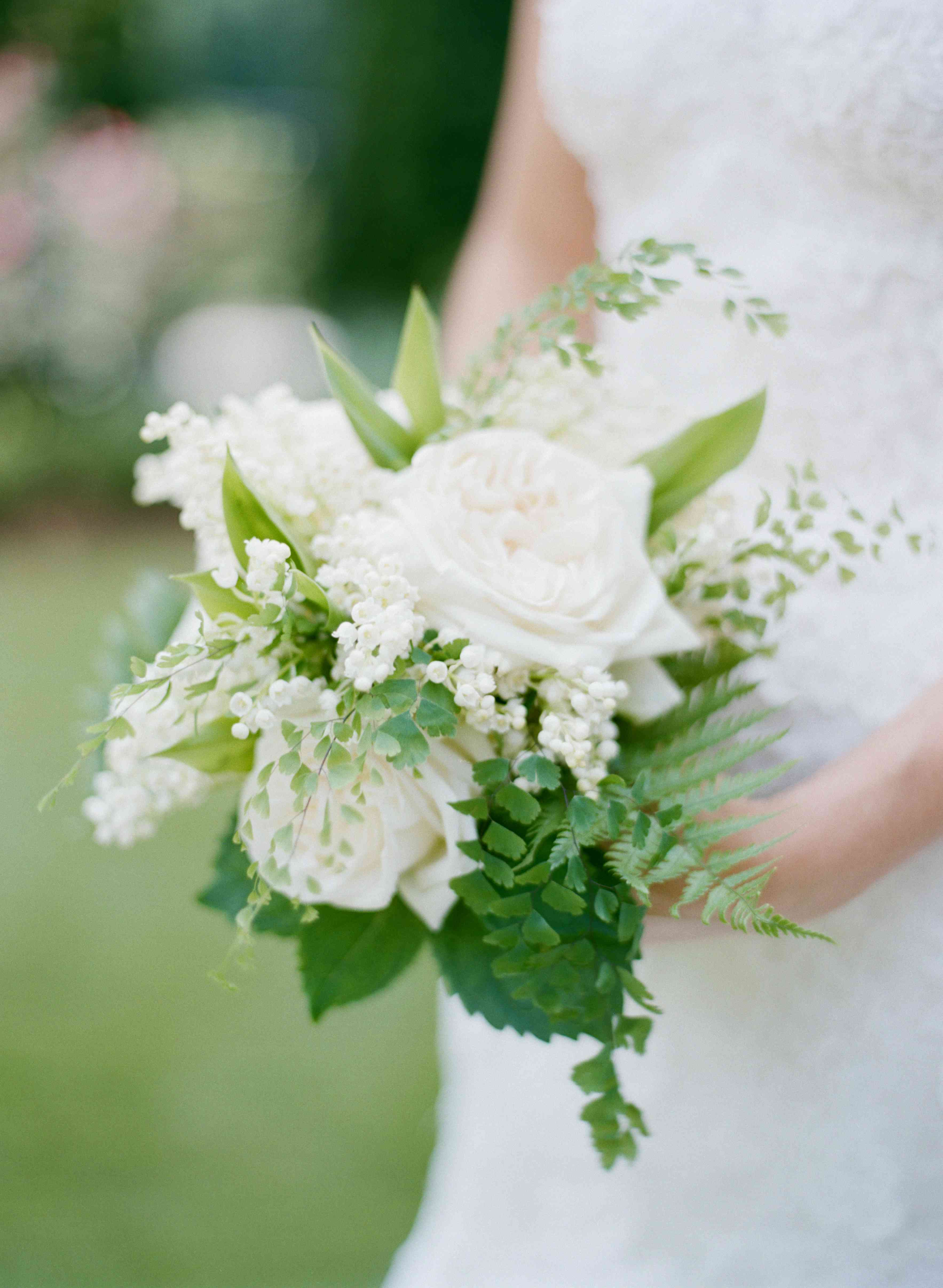 White bouquet with roses and lily of the valley