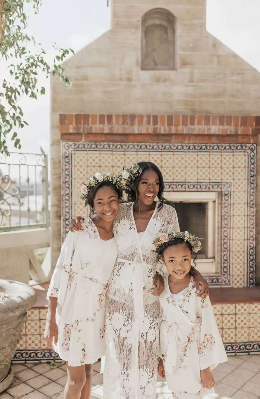 Bride with flower girls in robes