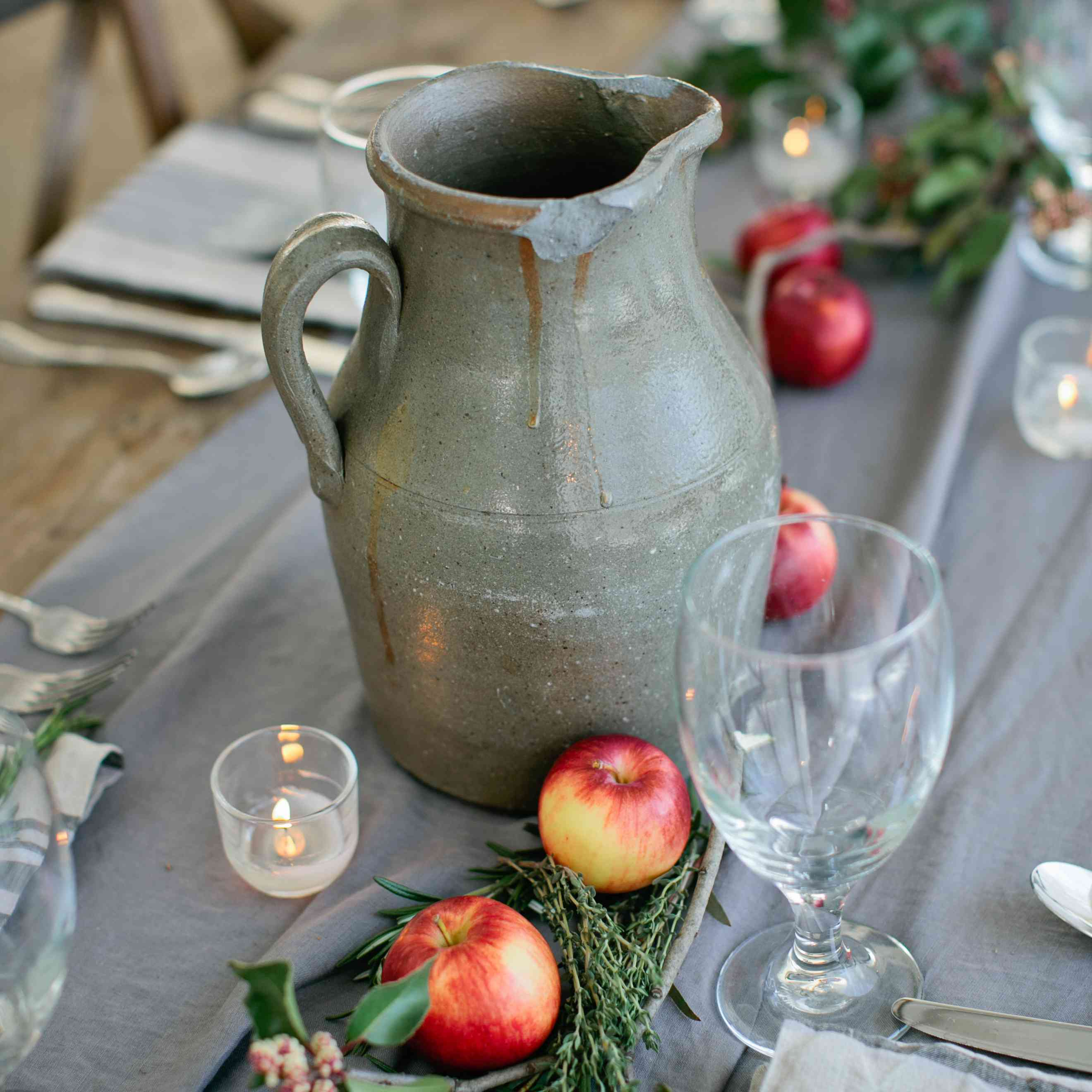 Apples with sprigs of greenery as a table centerpiece