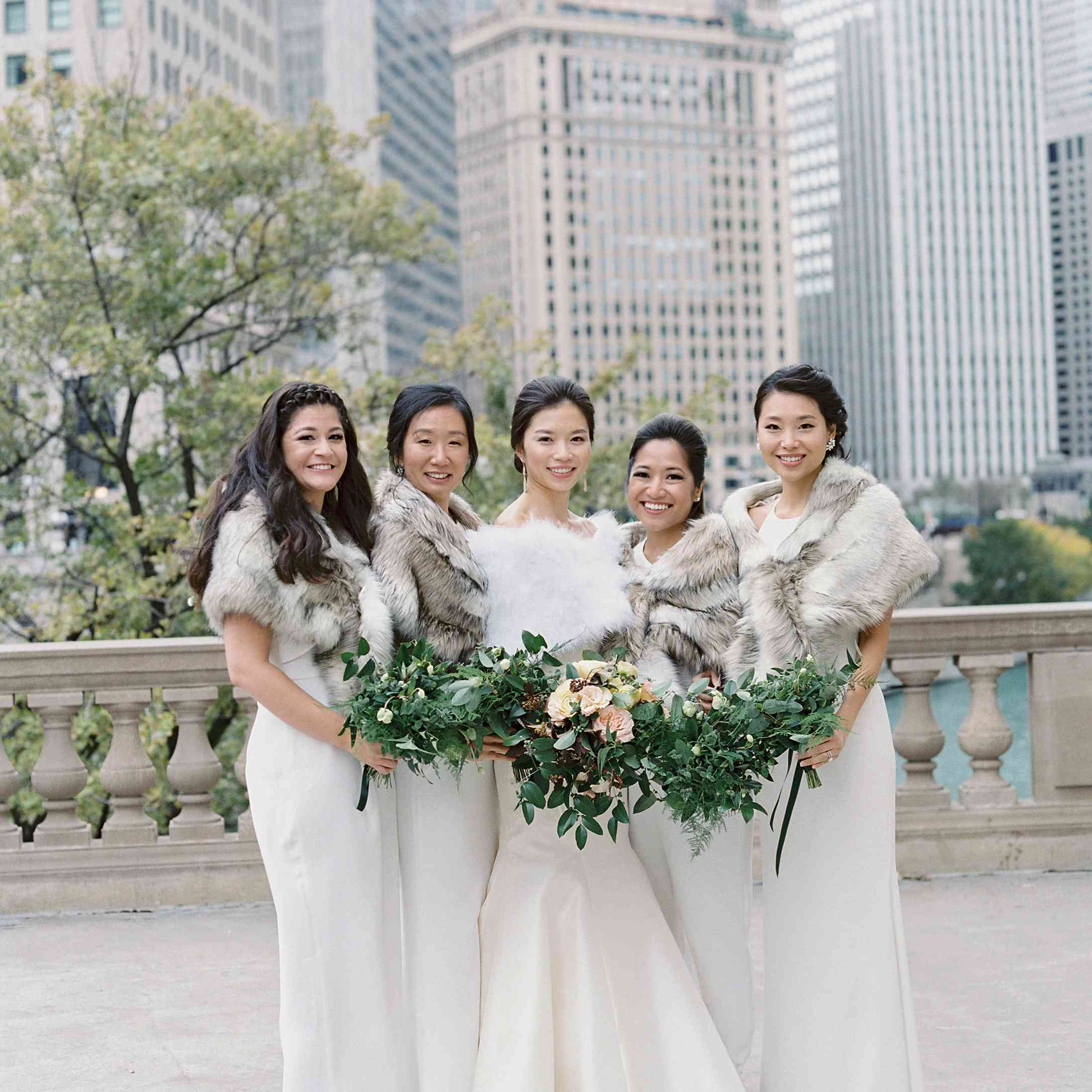brides and bridesmaids in all white and faux fur wraps