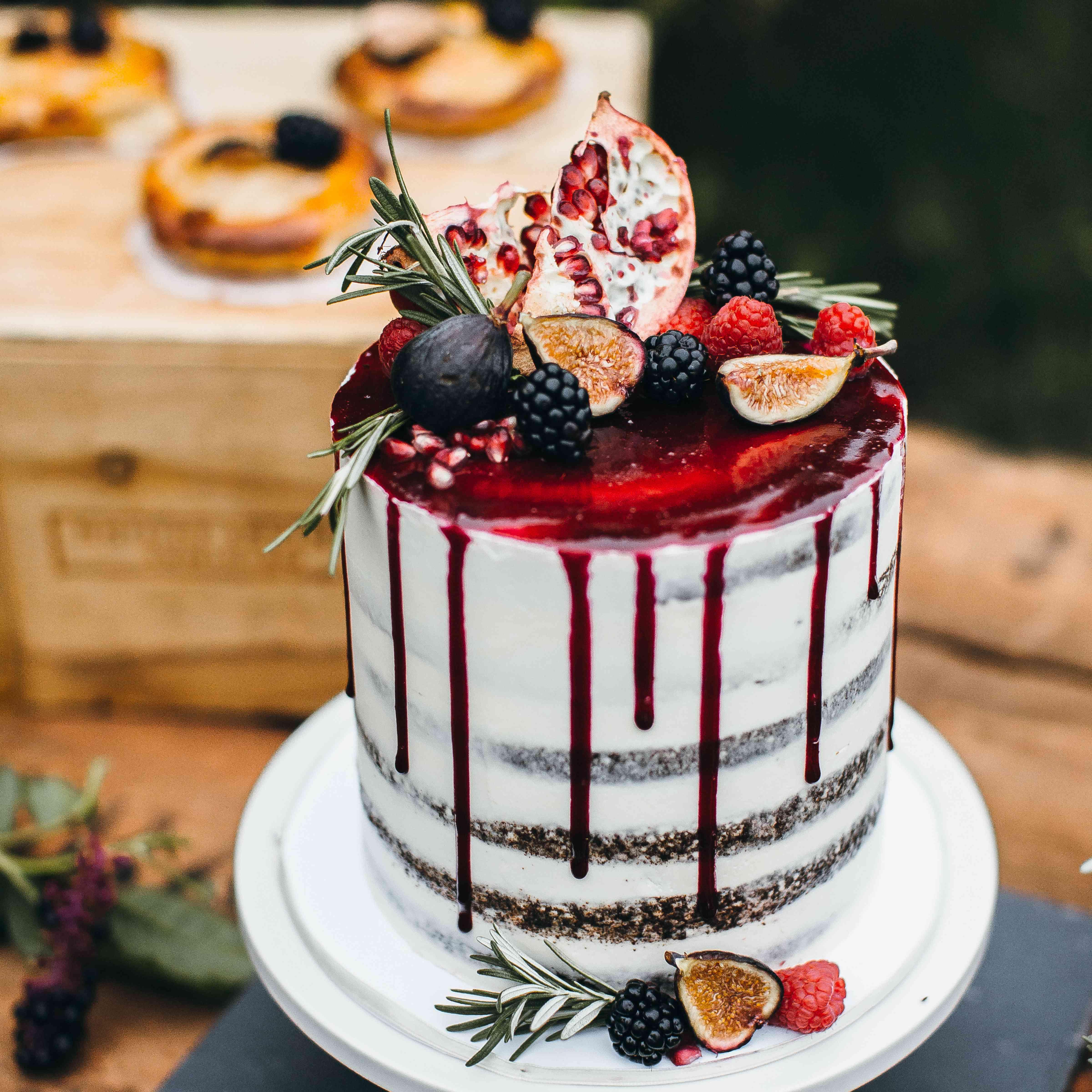 Nearly-Naked Drip Wedding Cake with Red Glaze