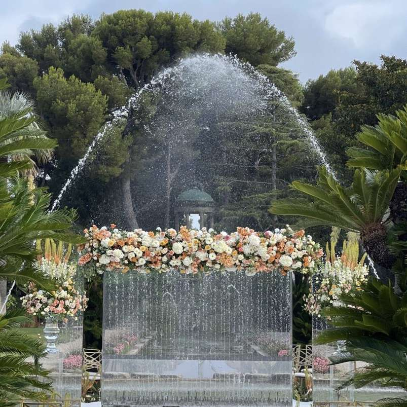 Issa Rae's wedding ceremony. Floral outdoor ceremony with water fountains and greenery.