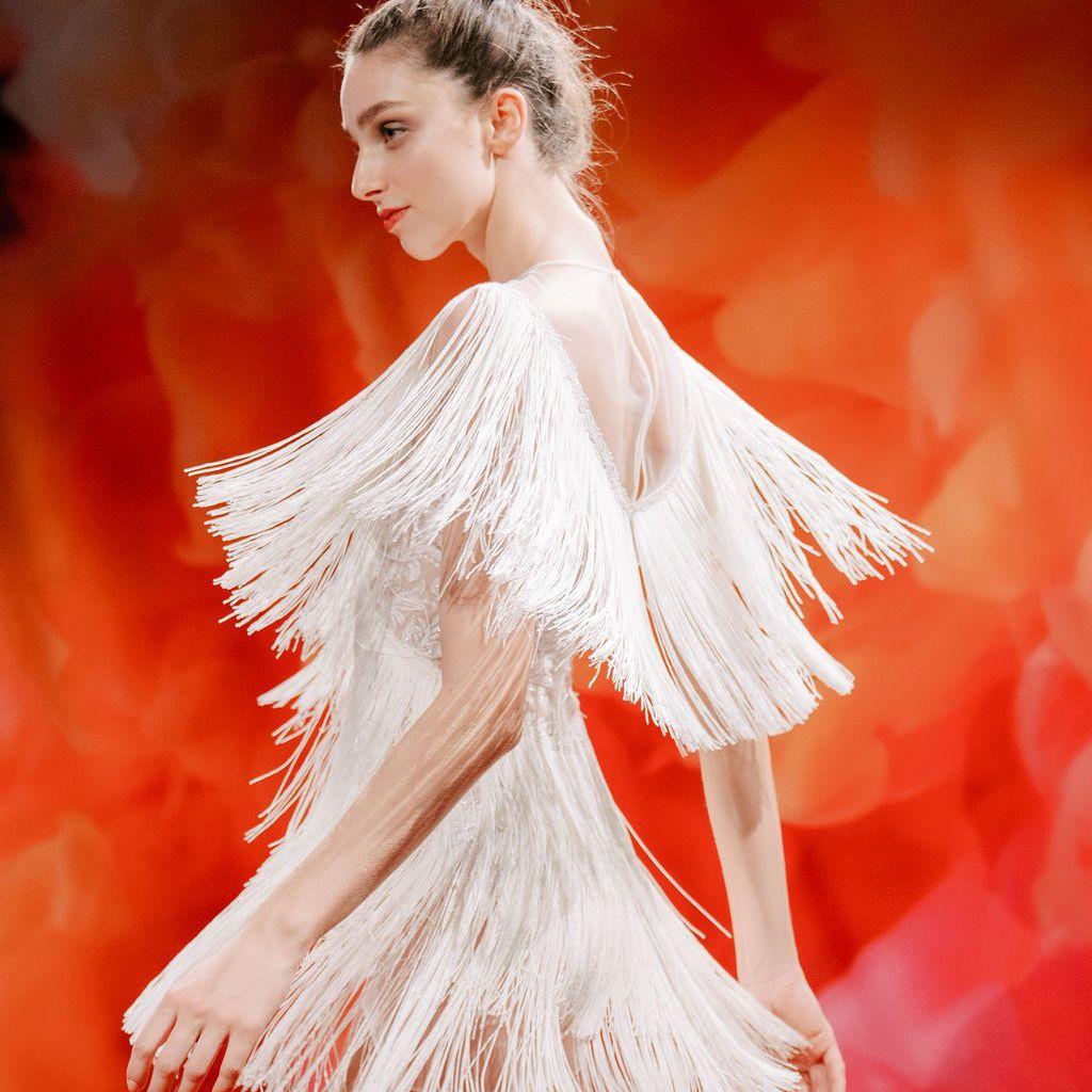 Model in short-sleeve fringe dress