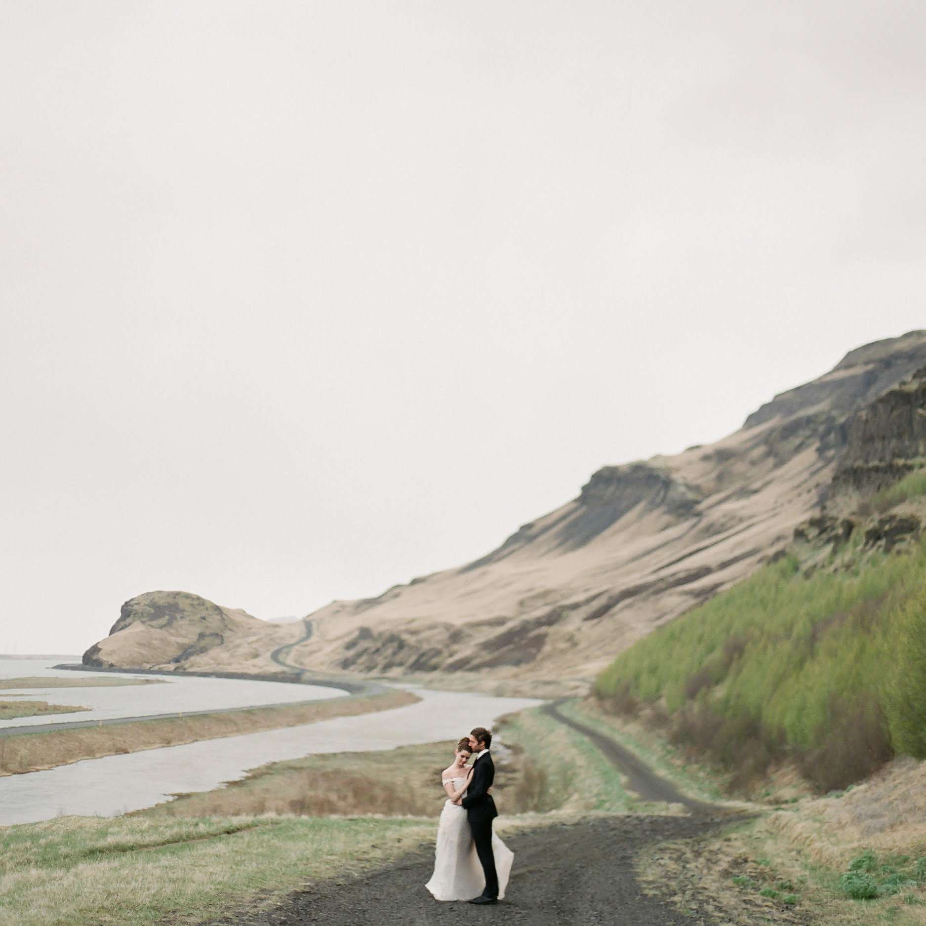 Couple hugging a on road in Iceland