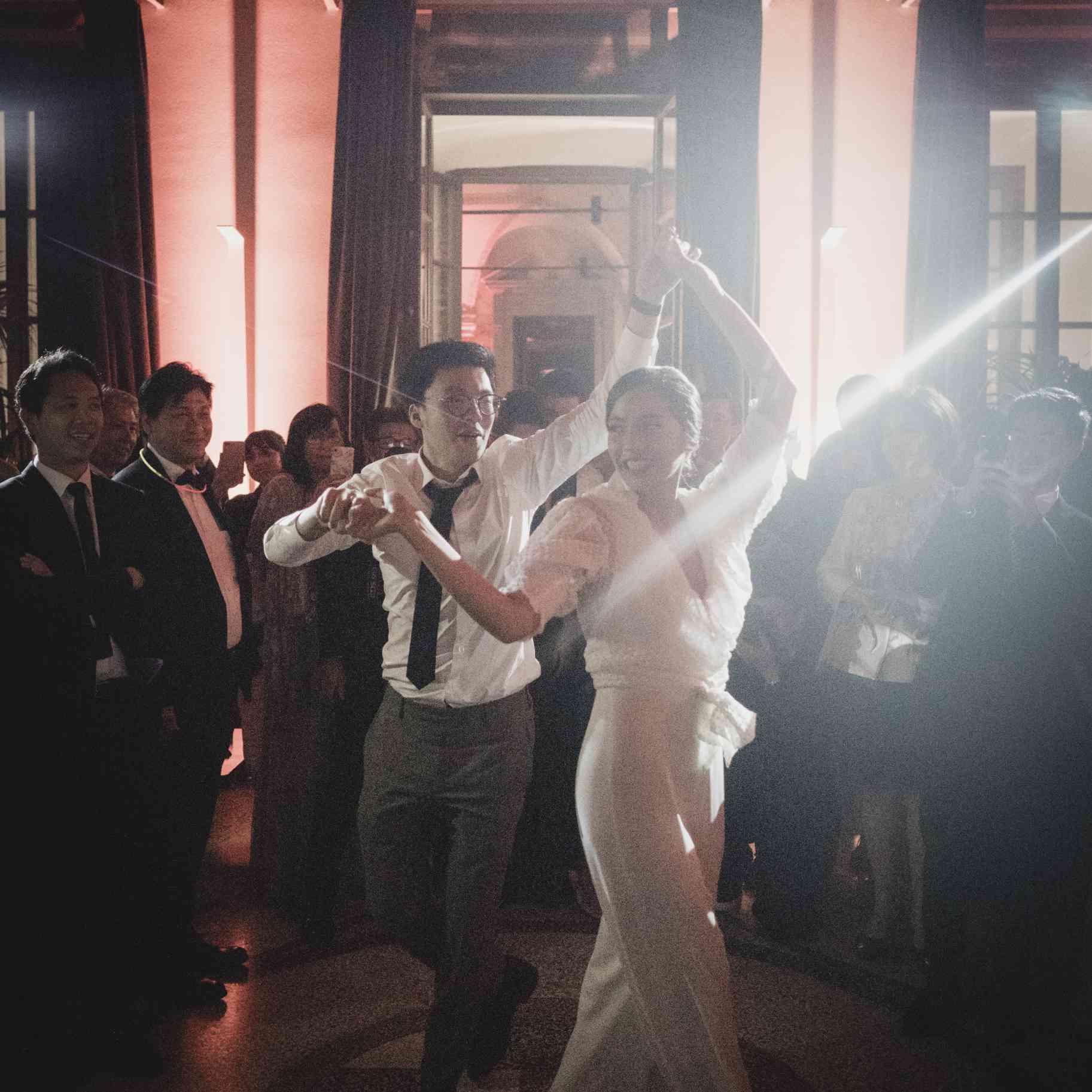 romantic lake como wedding, bride and groom dancing afterparty