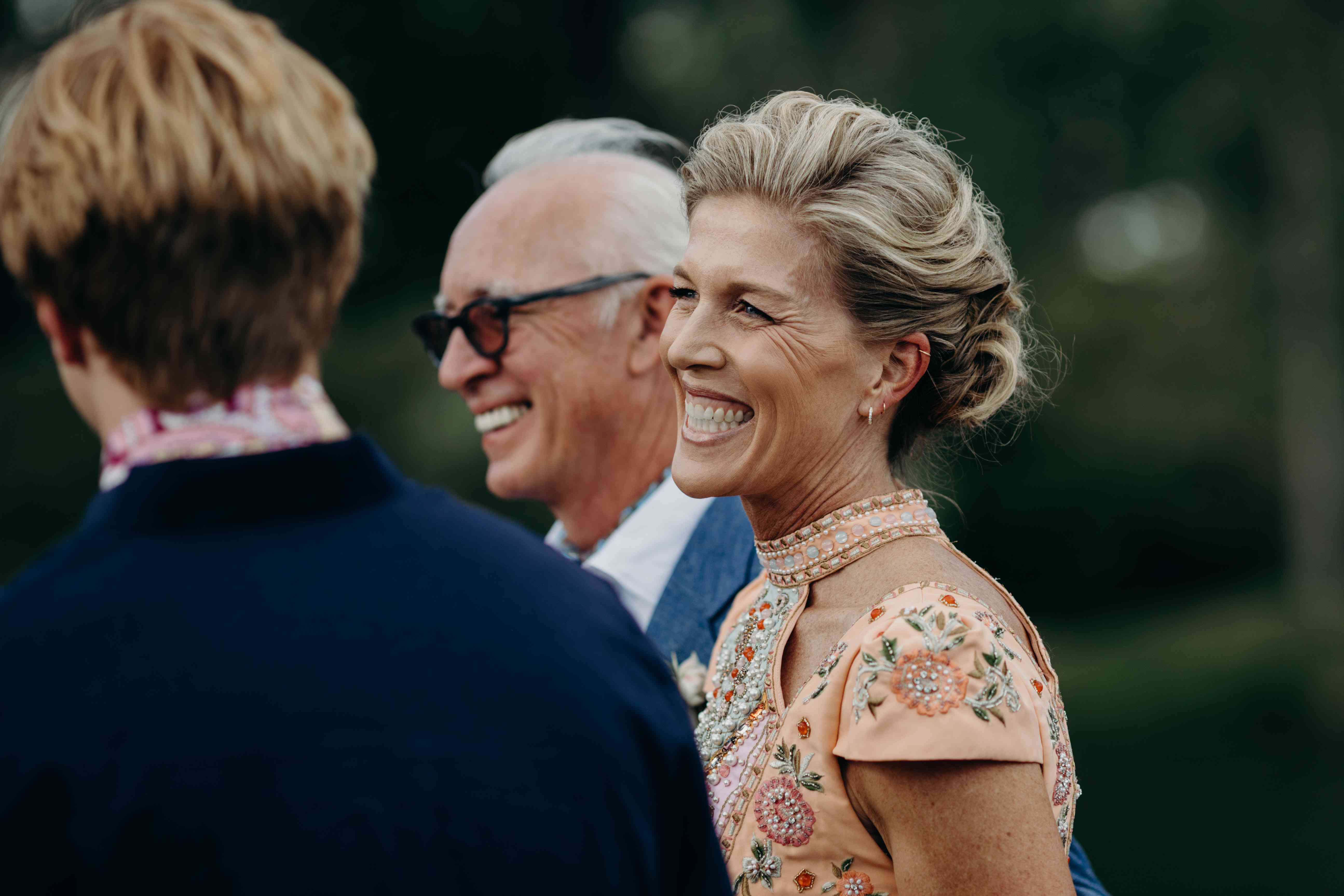 woman smiling at a wedding