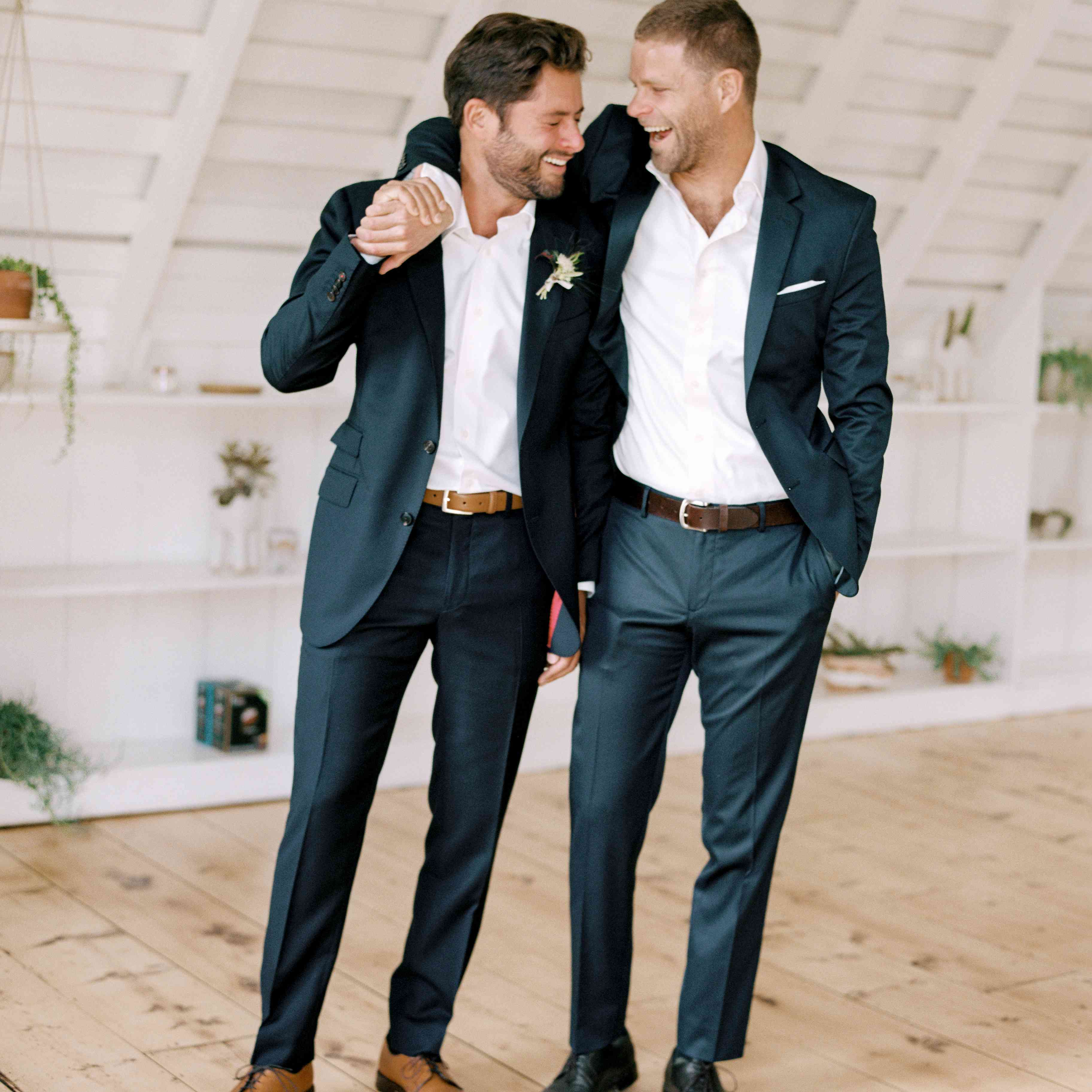 groom laughing with brother