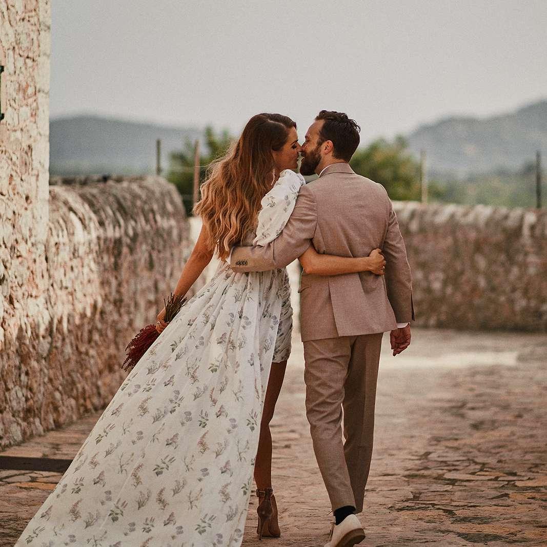 Man and woman kissing while walking