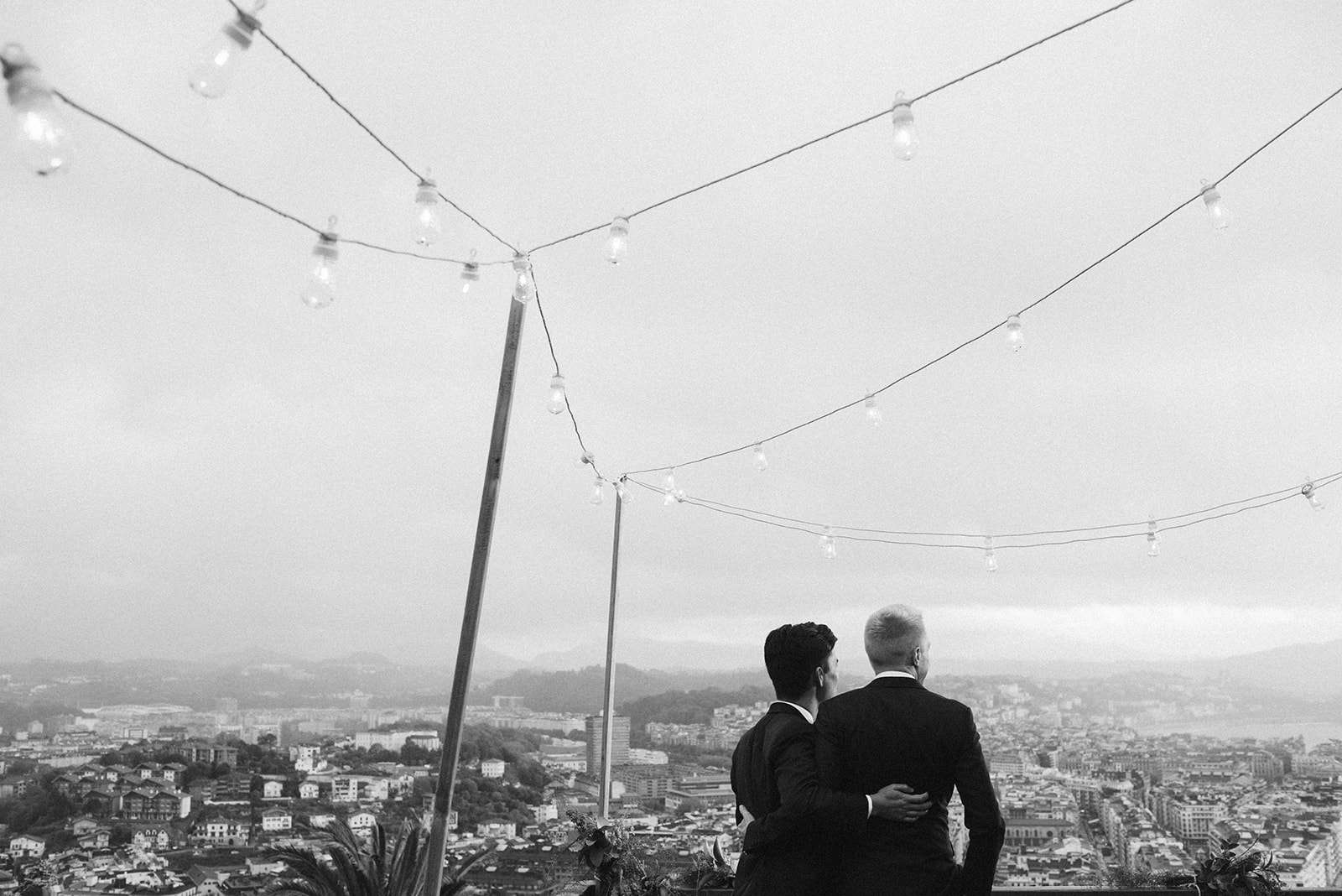 The grooms look out at the view