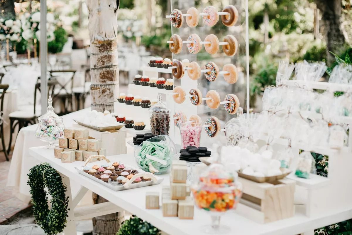 Candy and donut bar for wedding reception