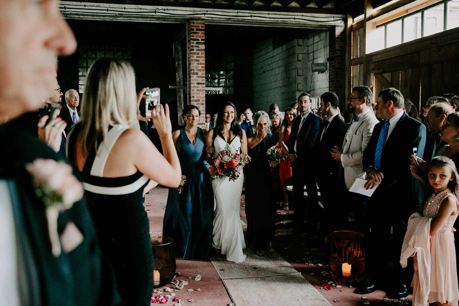 bride walking down aisle with sister
