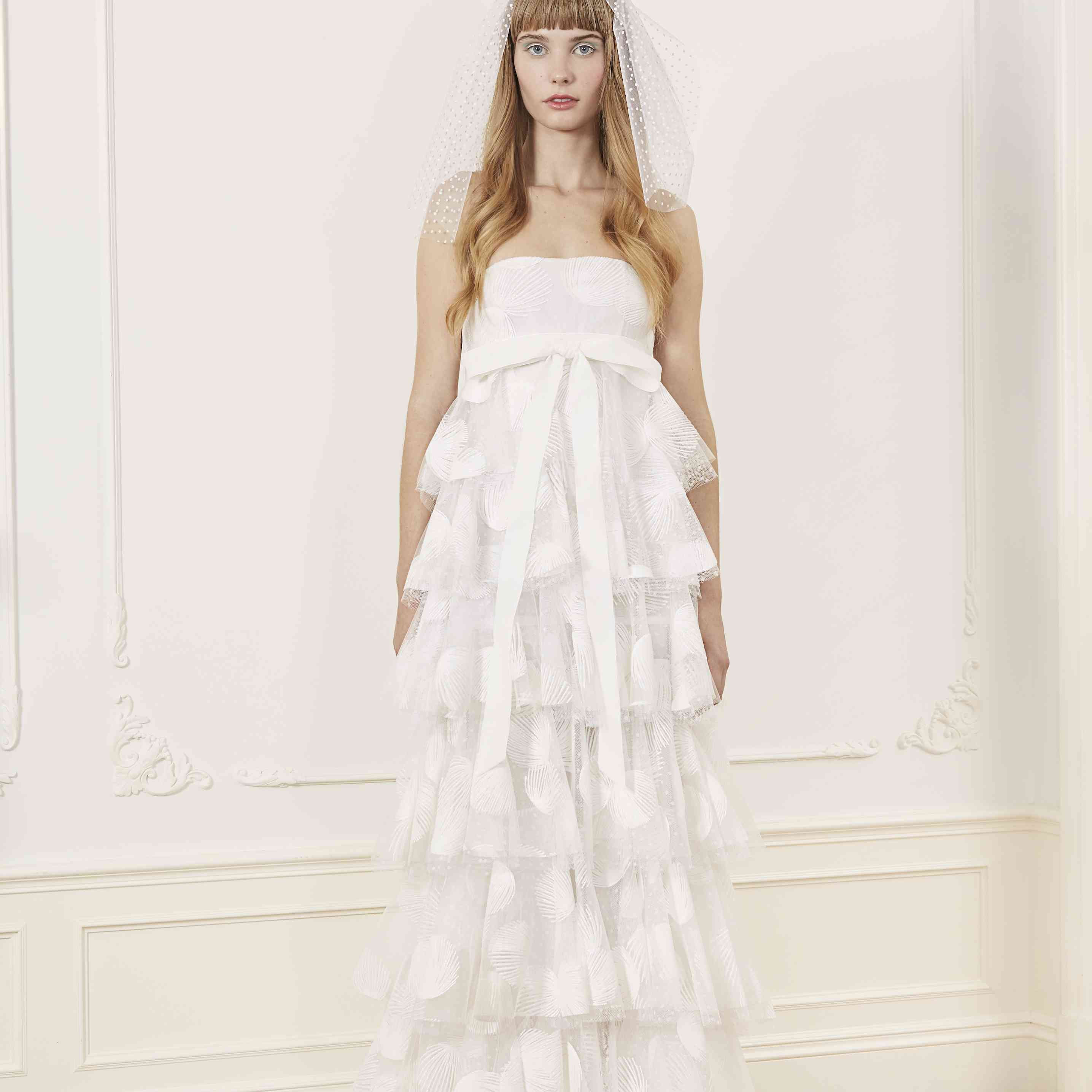 Model in tiered strapless wedding dress