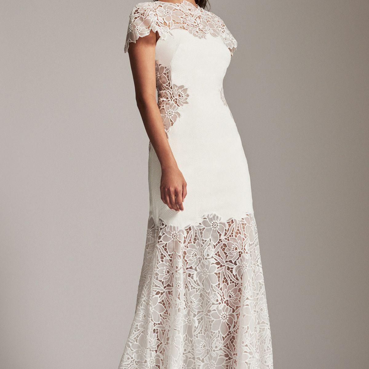 Model in illusion mermaid wedding gown