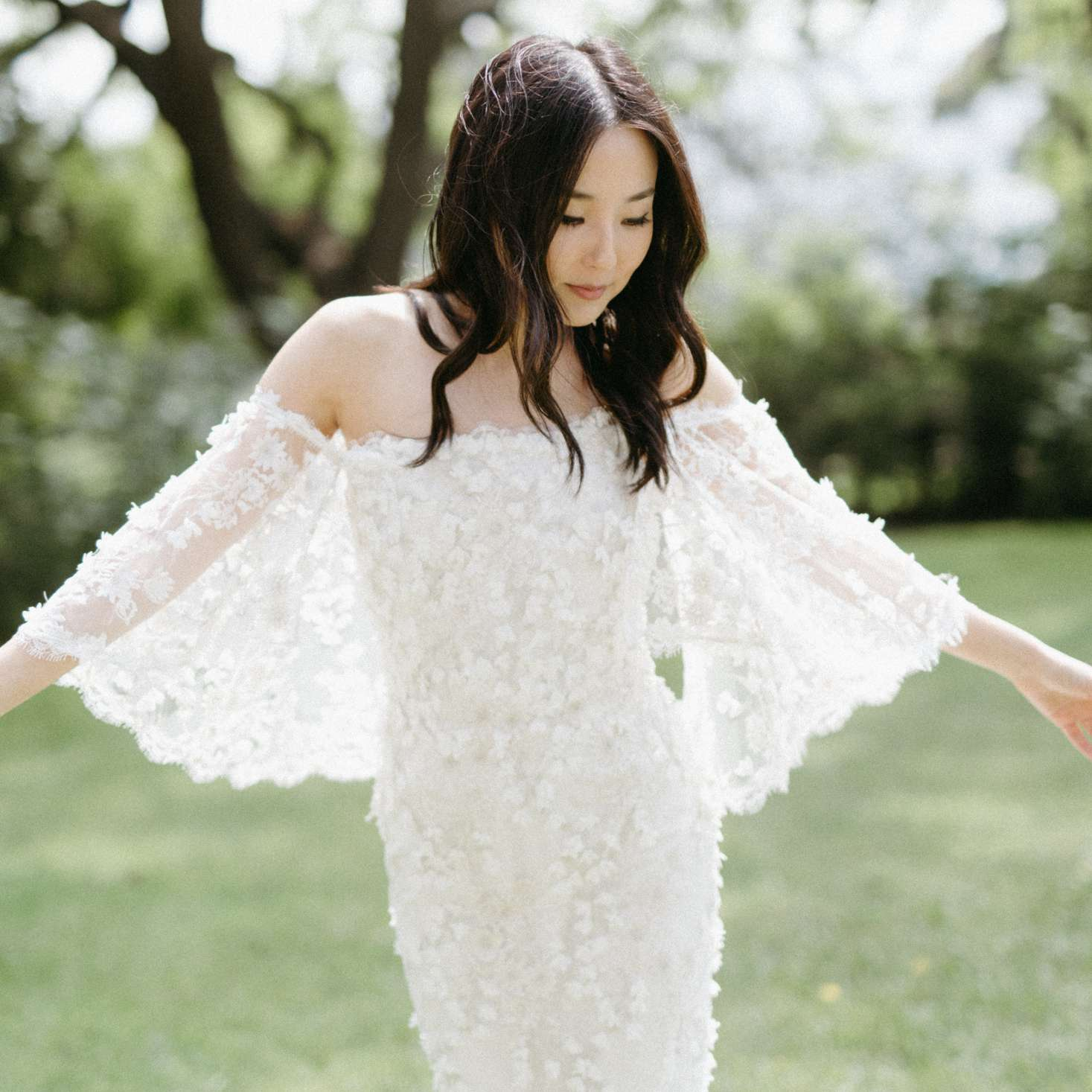 Bride twirling in wedding dress with flutter sleeves