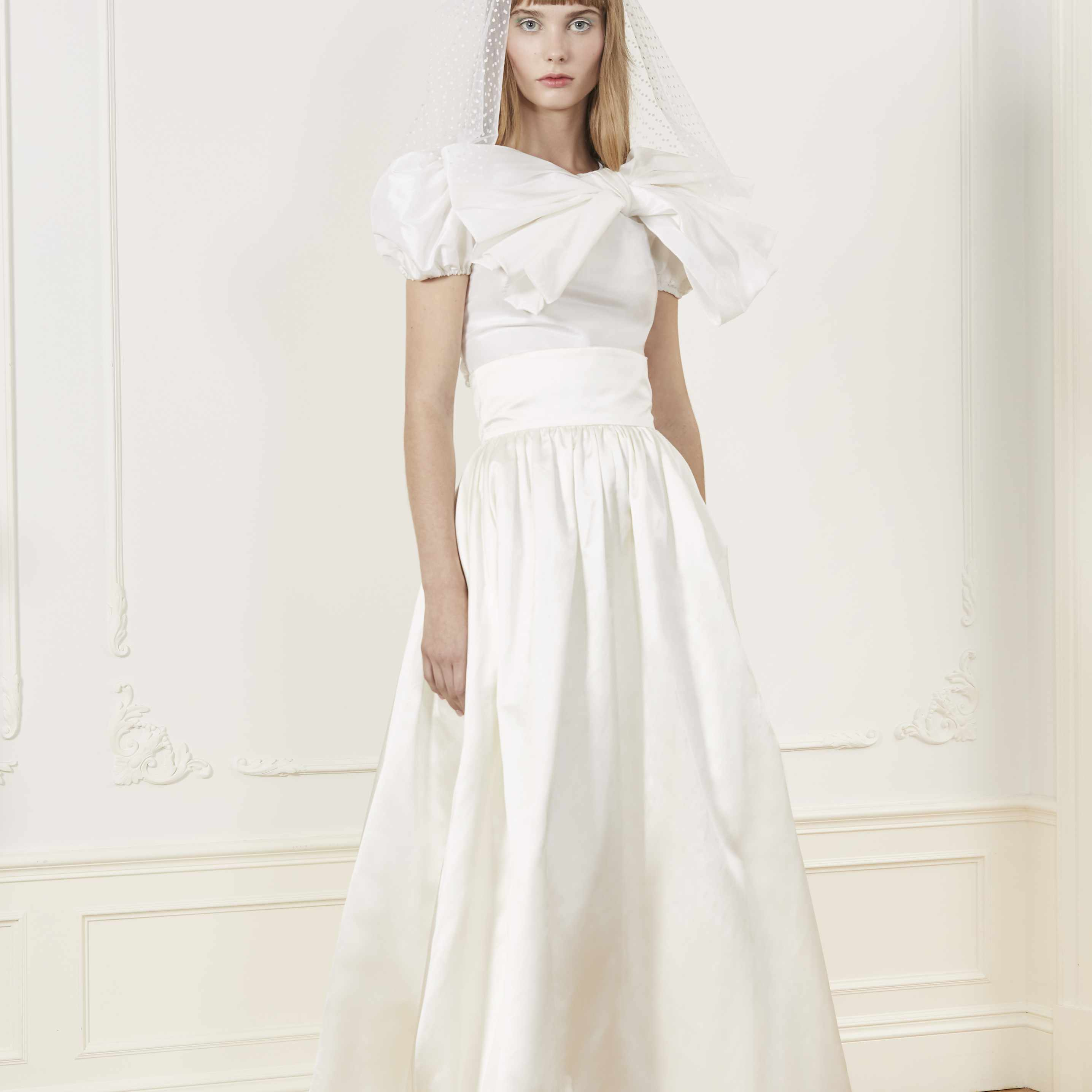 Model in two-piece wedding top and skirt