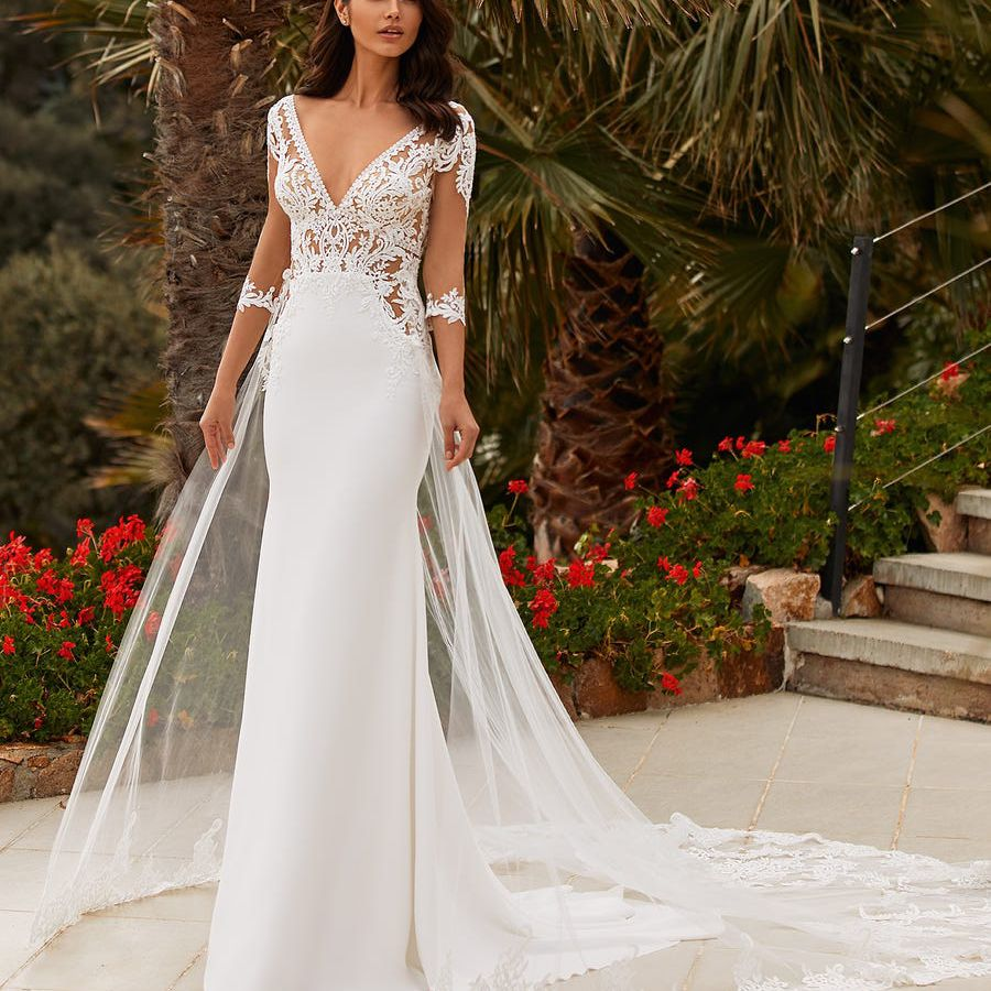 Model in illusion sleeve and bodice wedding dress