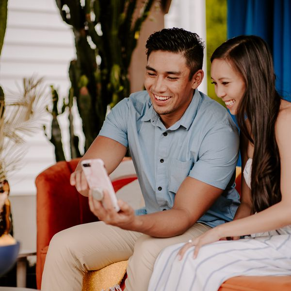Carrie & Paulo Watching the surprise honeymoon video