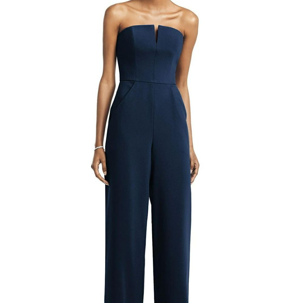 Model in a strapless blue jumpsuit