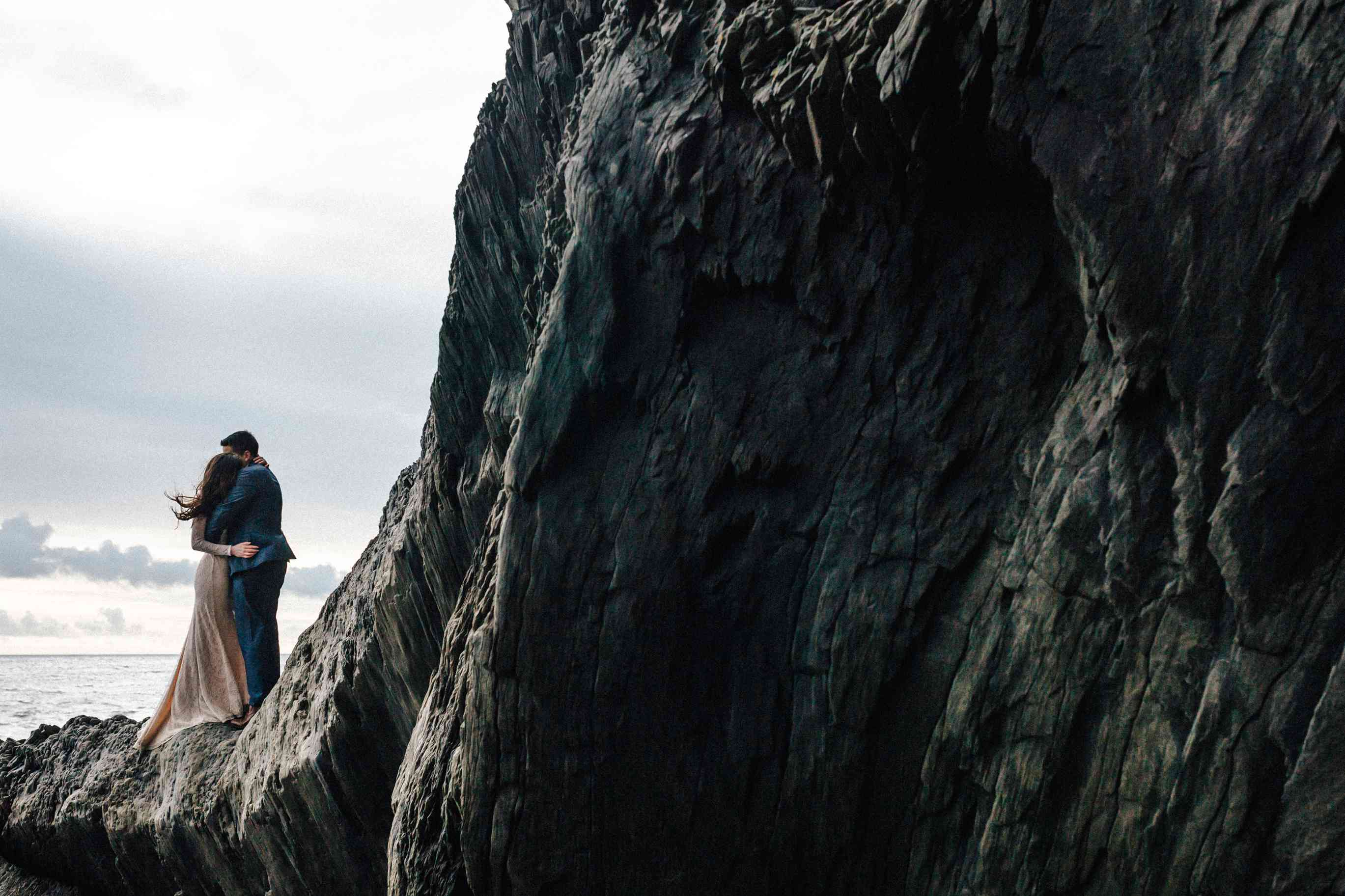 Couple hugging on an Icelandic rock