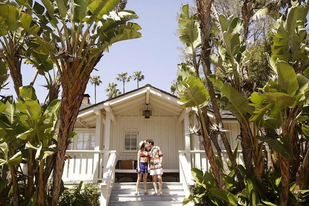 minimalist california wedding, bride and groom kissing swimsuits
