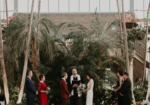 Couple standing during their wedding ceremony at The Jewel Box in Missouri