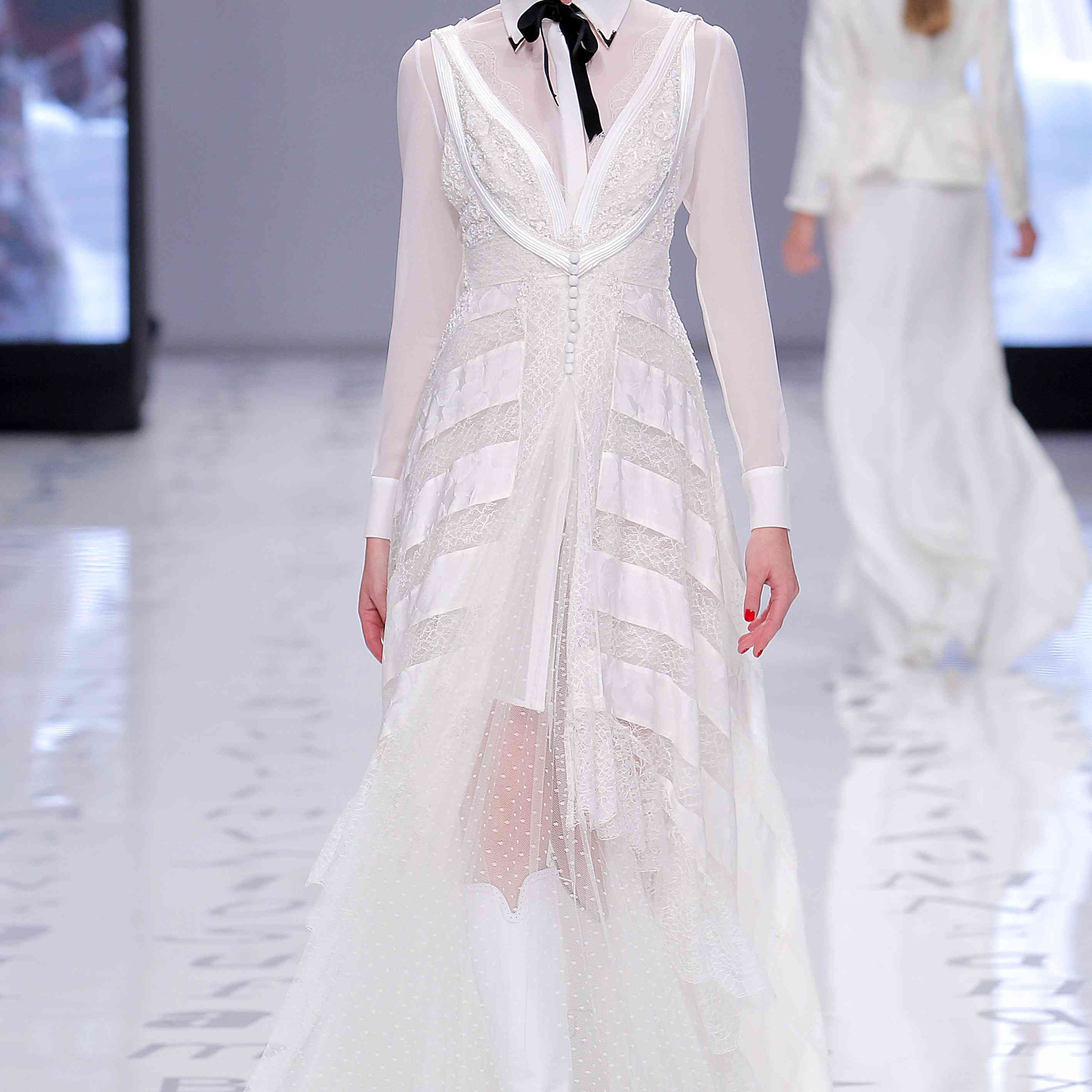 Model in long-sleeve collared dress of lace and dotted tulle with silk accents