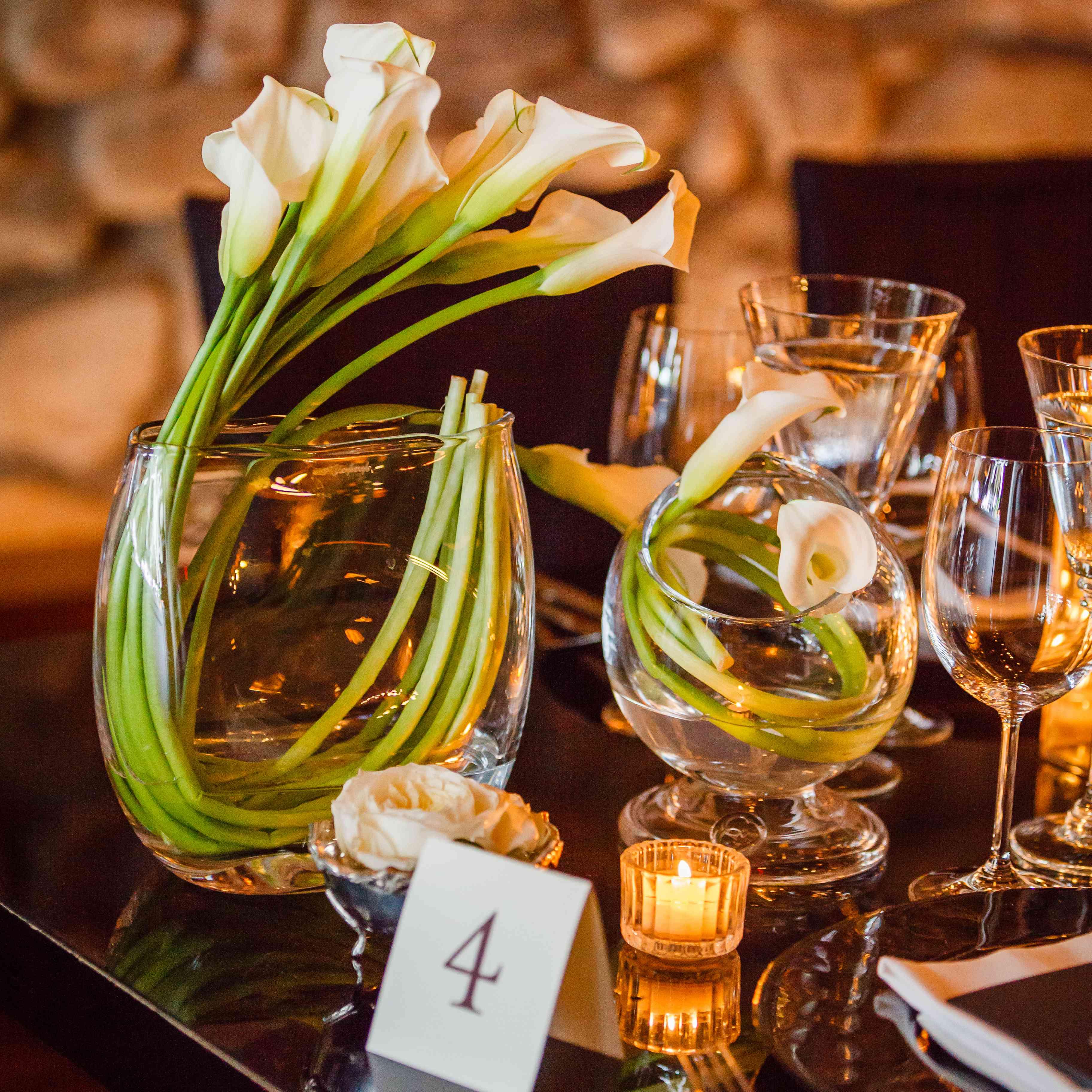 white flowers in modern vases