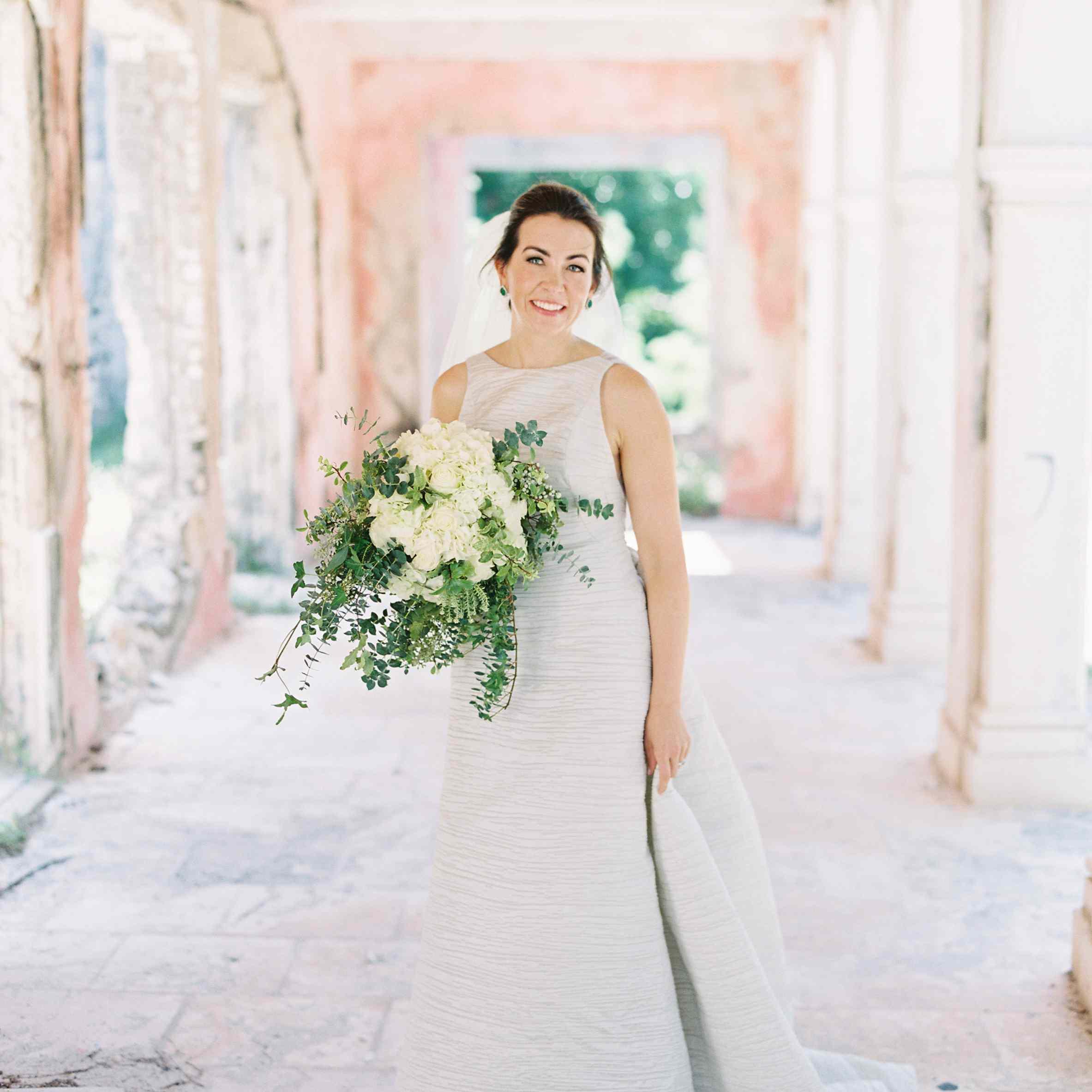 <p>bride holding wedding bouquet</p><br><br>