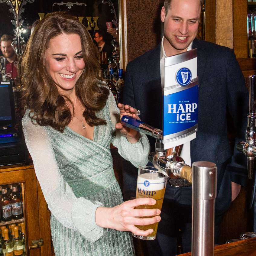 kate middleton and prince william pouring beer