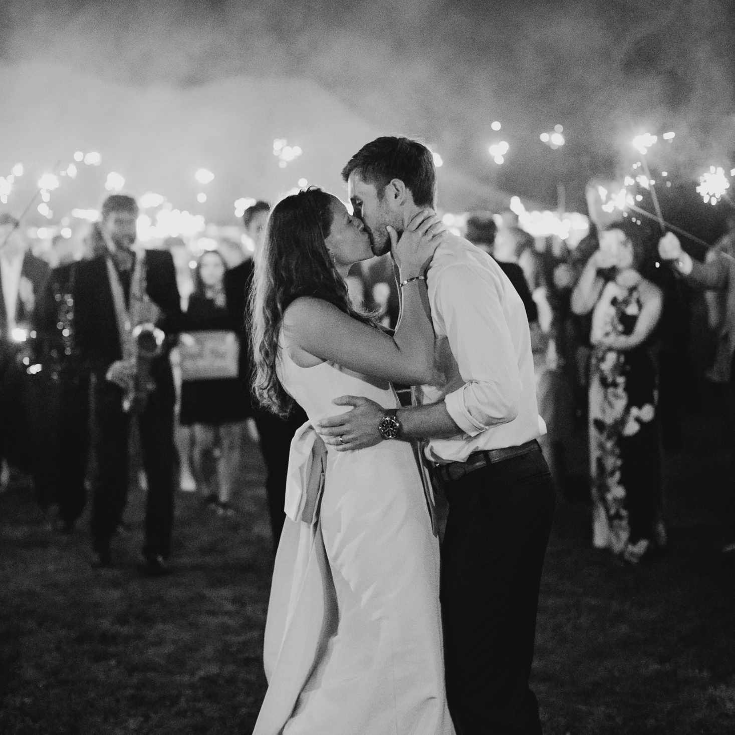 at-home rustic massachusetts wedding, bride and groom kissing sparklers