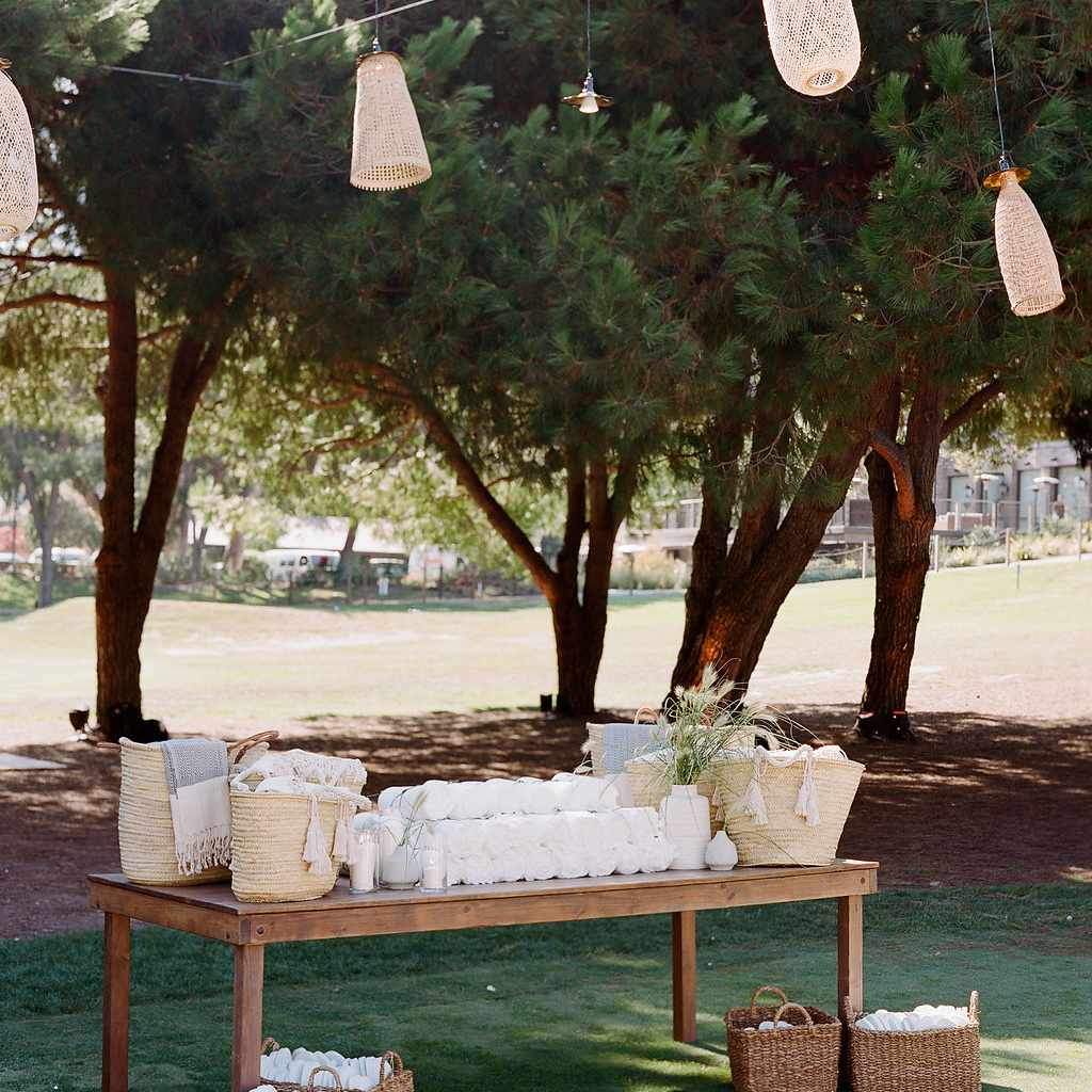 Outdoor welcome station with favors