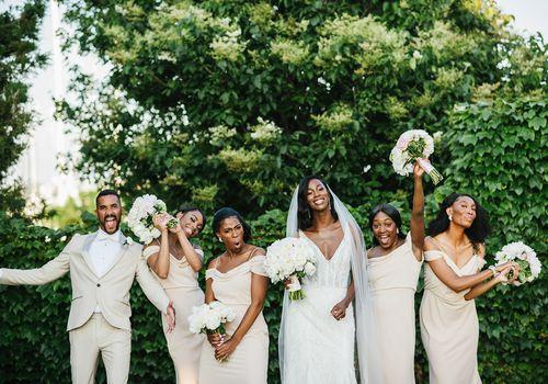 Bridesman with bride and bridesmaids