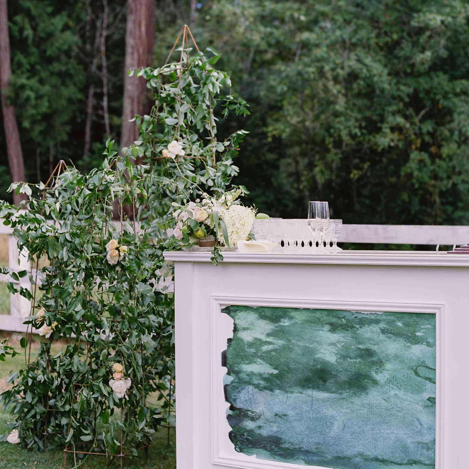 bar at wedding reception next to large floral decoration