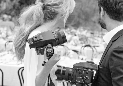 people holding cameras
