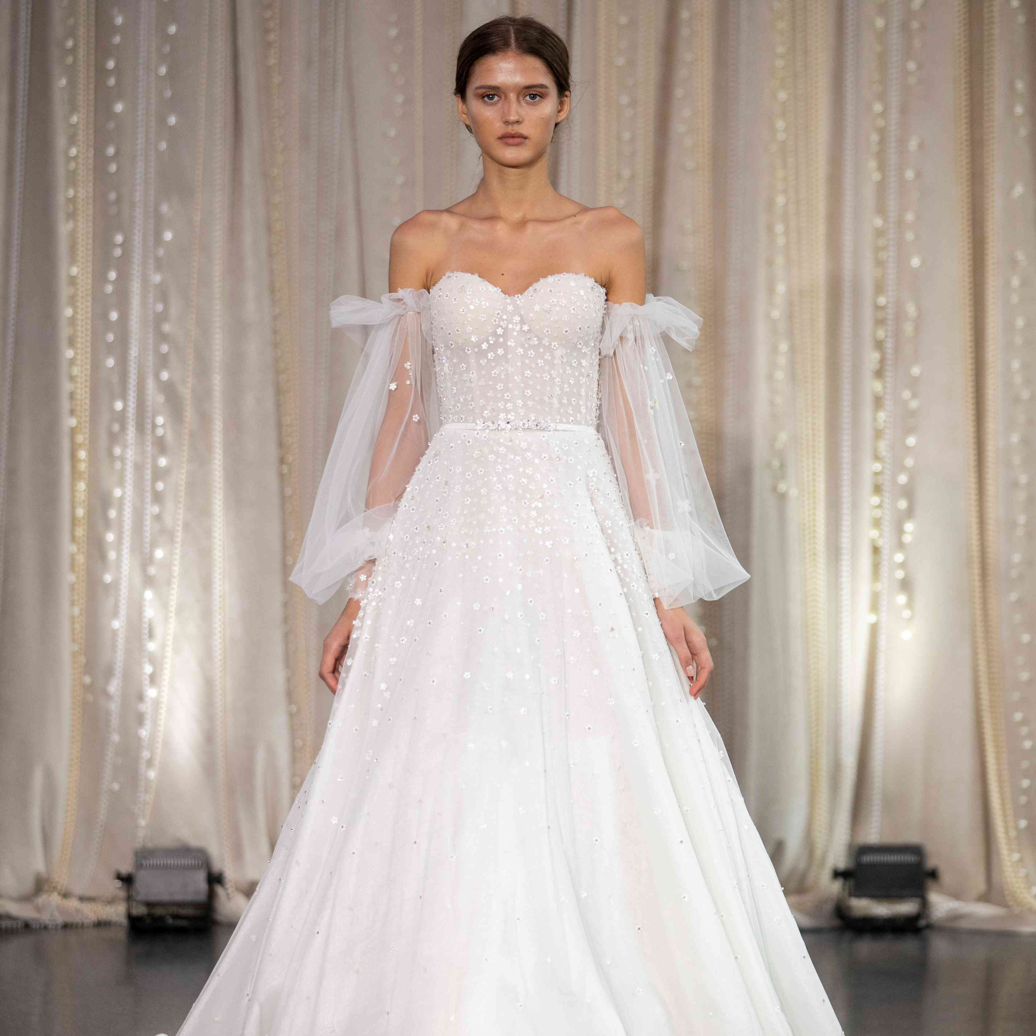 Model in off-the-shoulder wedding ball gown