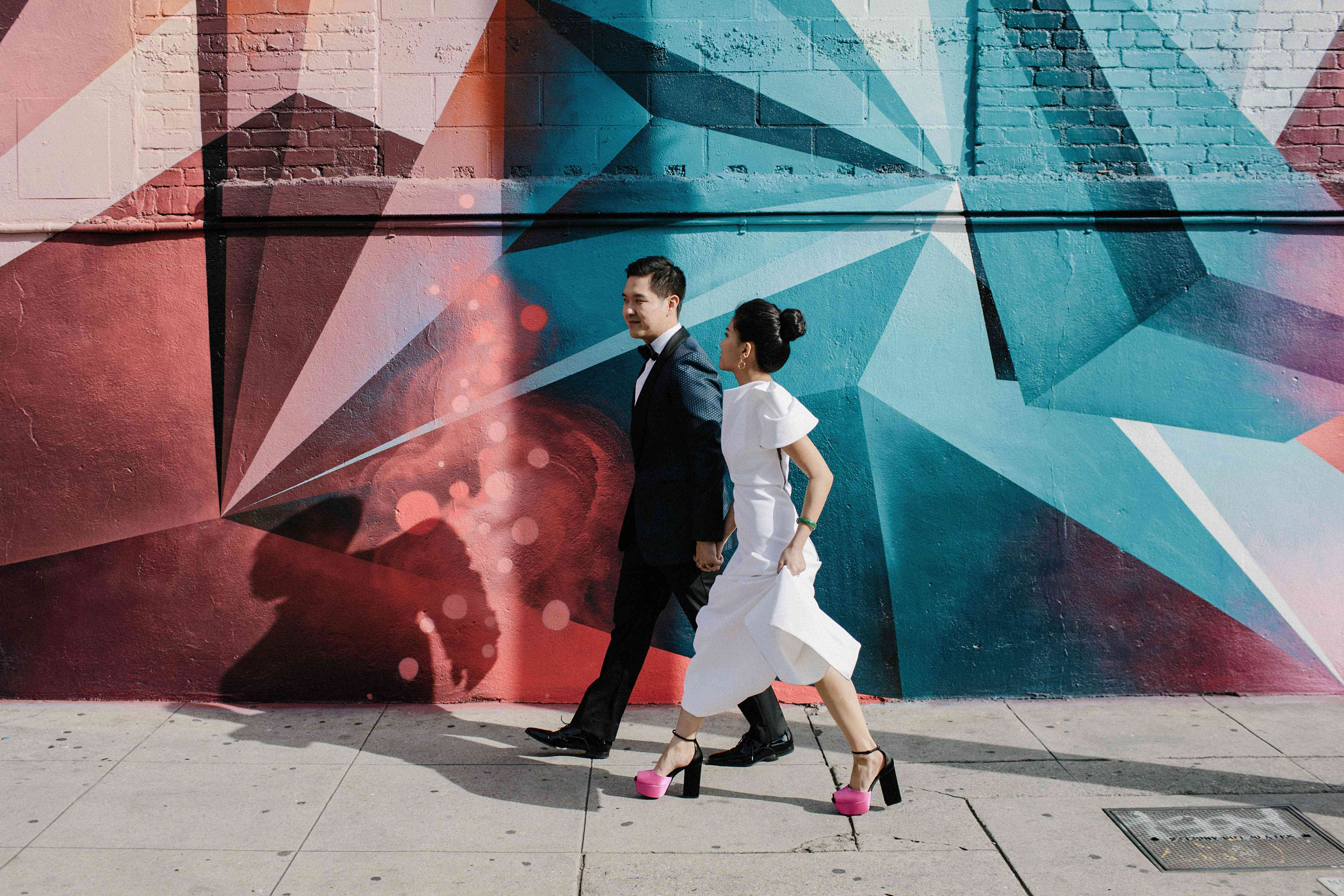 <p>Bride and groom with mural</p><br><br>