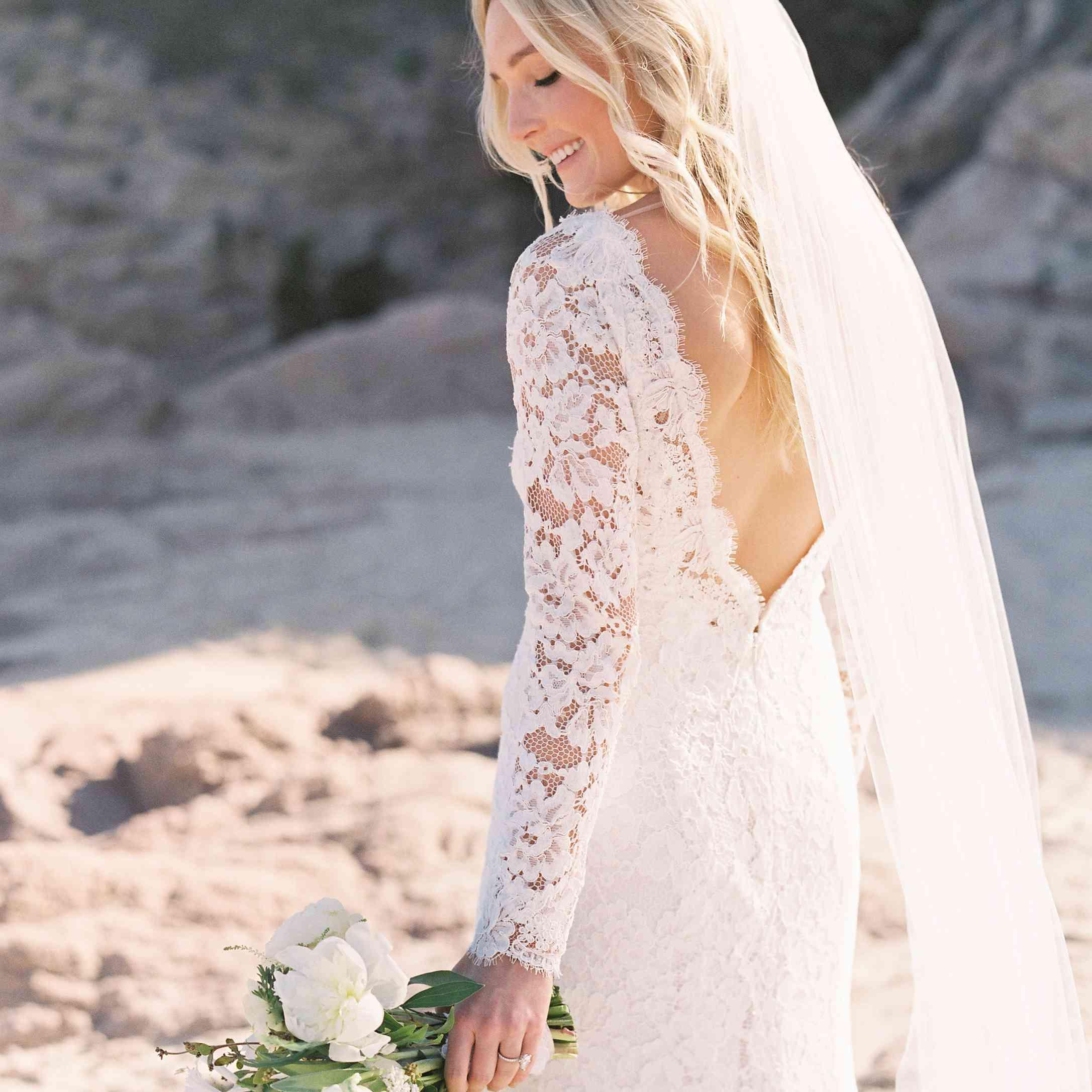 bride in backless wedding dress