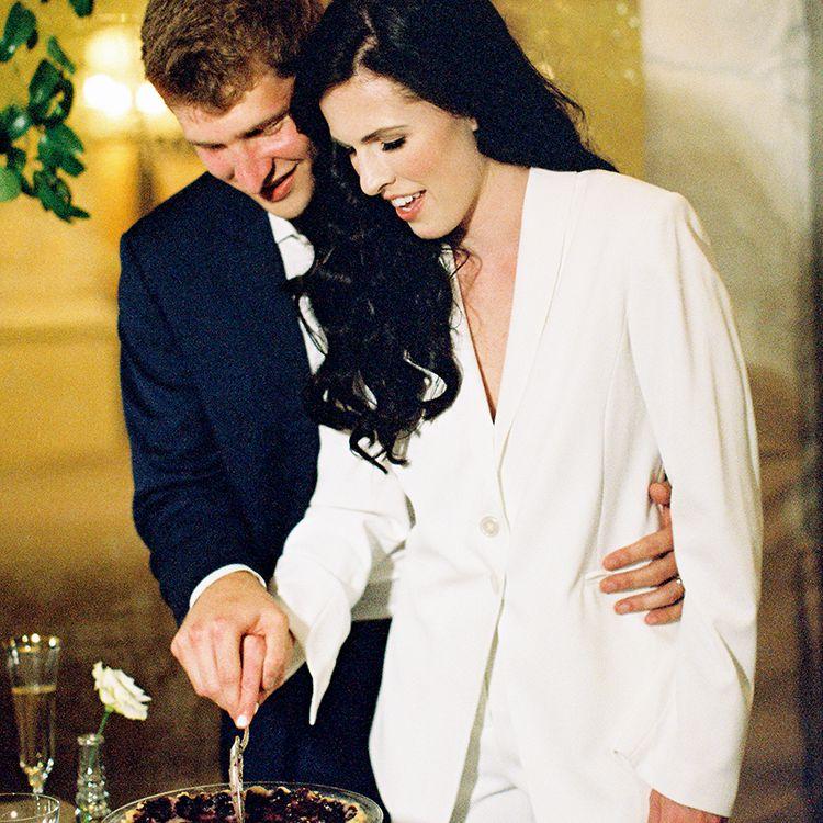 <p>bride and groom cut pie</p><br><br>