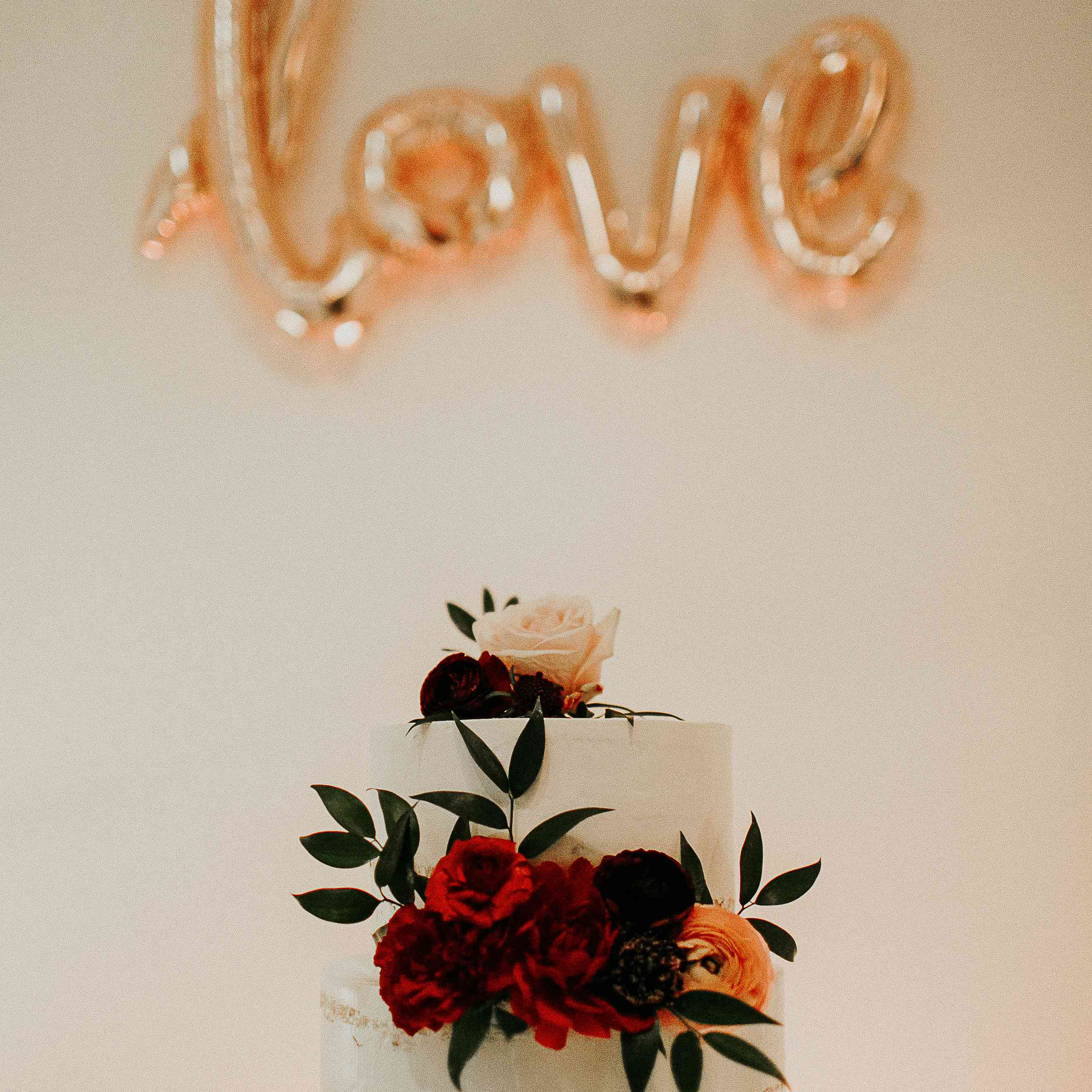 Two-Tiered Naked Wedding Cake with Red Flowers