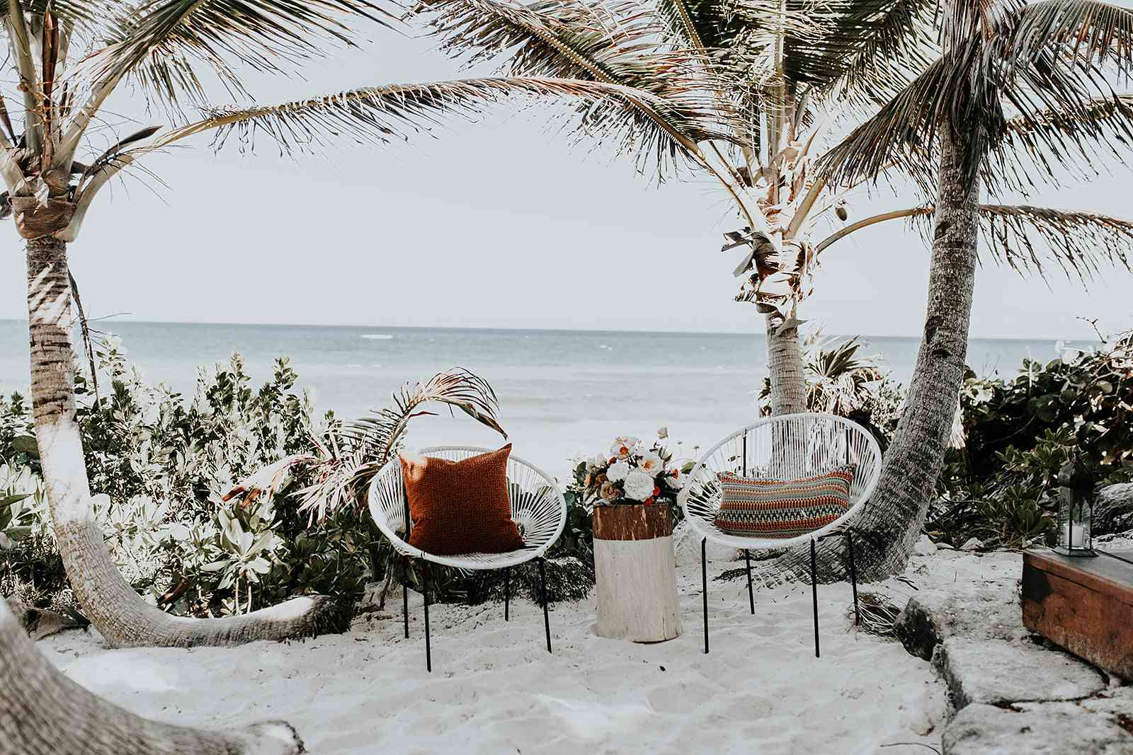 Two Acapulco wedding chairs on the beach