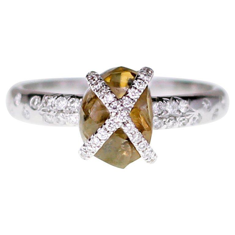 Brown rough diamond wrapped with white round diamonds in white gold setting